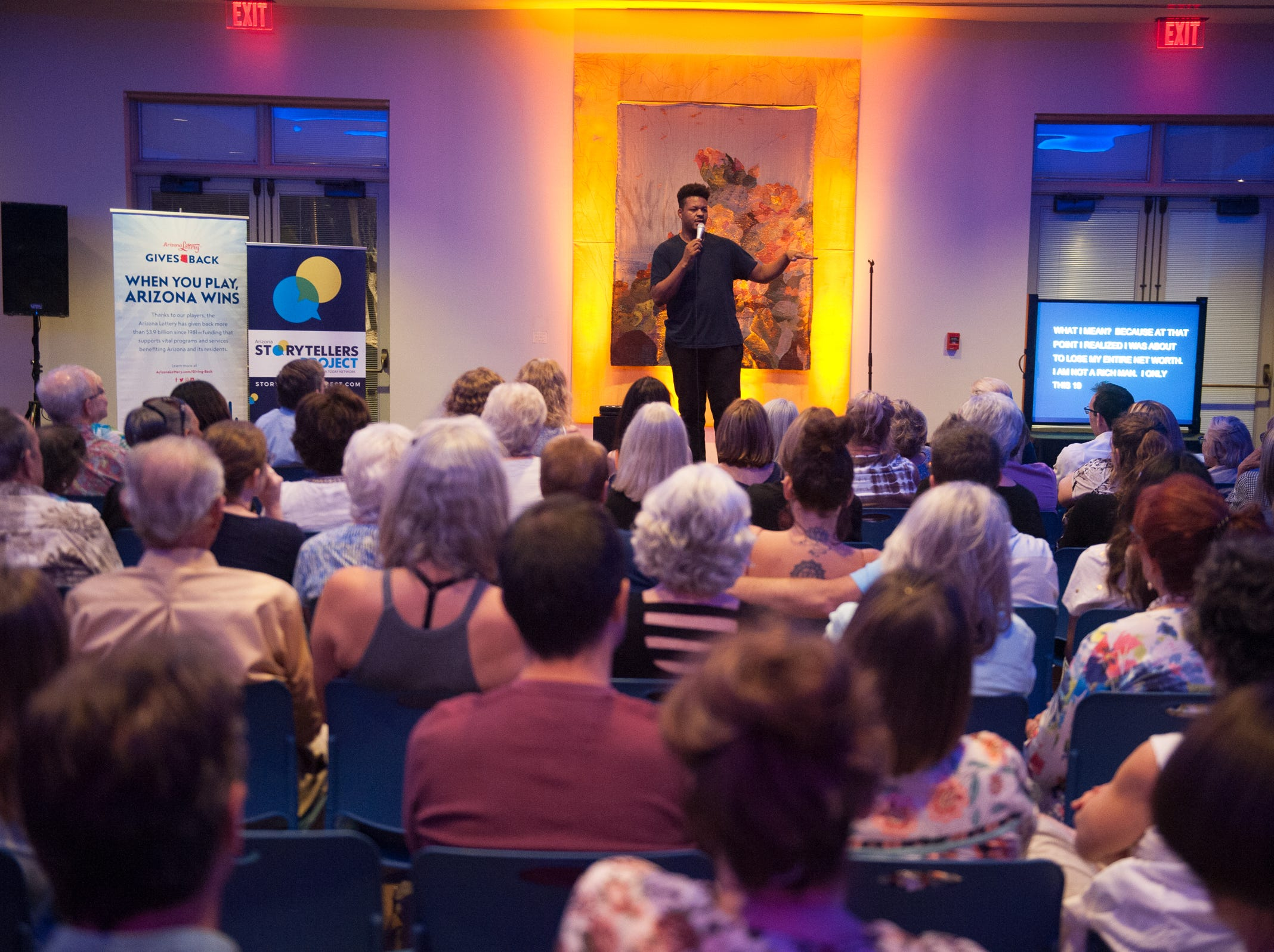 Anwar Newton tells his tale during Arizona Storytellers Project presents Searching at the Desert Botanical Garden in Phoenix on Thursday, Sep. 13, 2018.