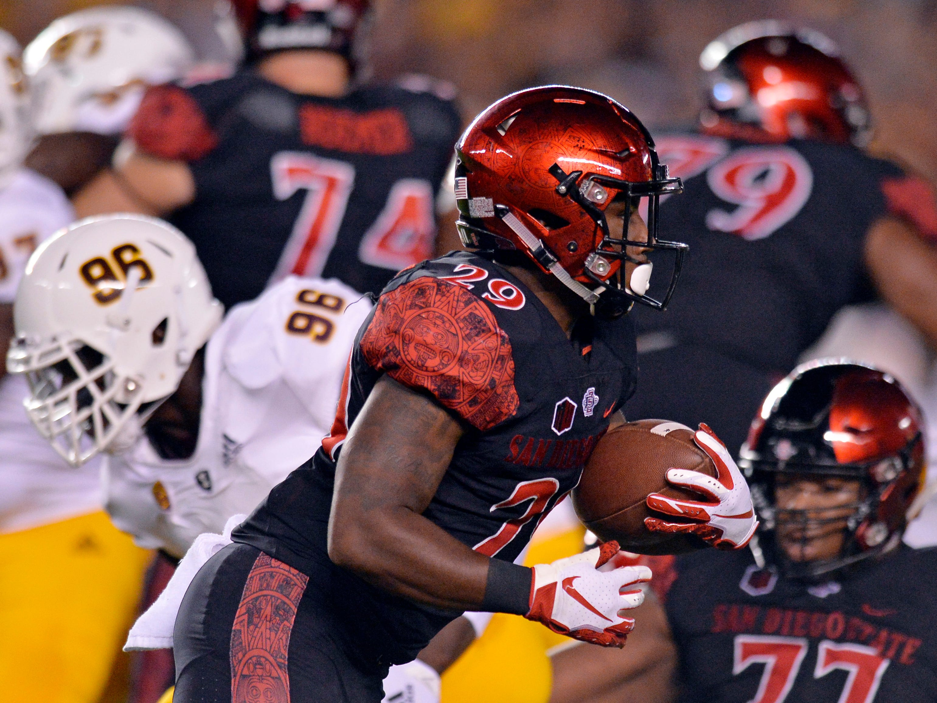 Sep 15, 2018; San Diego, CA, USA; San Diego State Aztecs running back Juwan Washington (29) runs against the Arizona State Sun Devils during the first quarter at SDCCU Stadium. Mandatory Credit: Jake Roth-USA TODAY Sports