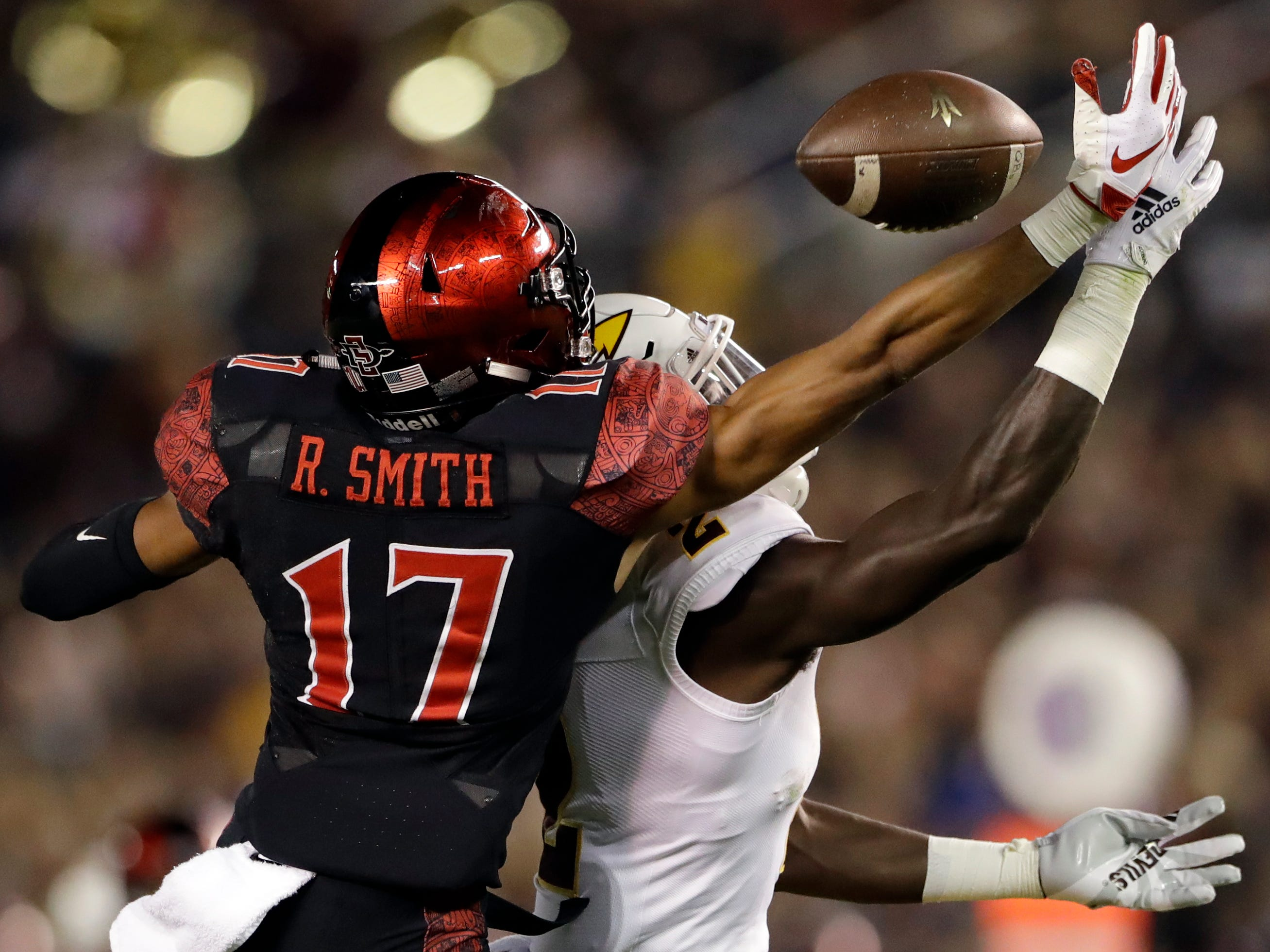 San Diego State cornerback Ron Smith (17) breaks up a pass intended for Arizona State wide receiver Brandon Aiyuk during the first half of an NCAA college football game, Saturday, Sept. 15, 2018, in San Diego. (AP Photo/Gregory Bull)