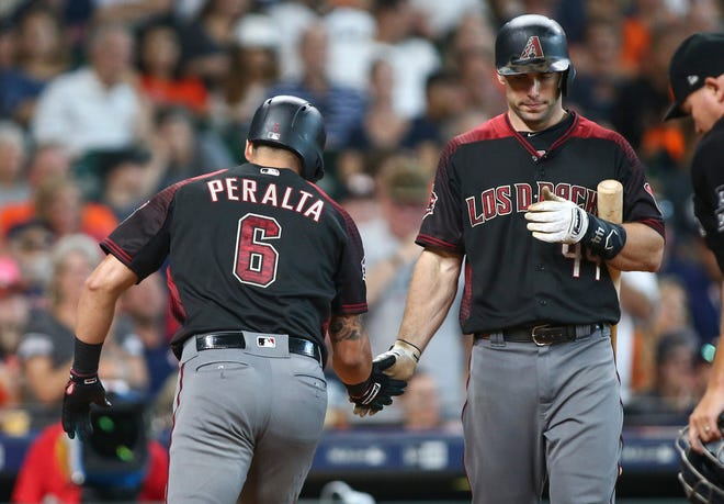 Sep 16, 2018; Houston, TX, USA; Arizona Diamondbacks left fielder David Peralta (6) celebrates with first baseman Paul Goldschmidt (44) after hitting a home run during the sixth inning against the Houston Astros at Minute Maid Park. Mandatory Credit: Troy Taormina-USA TODAY Sports