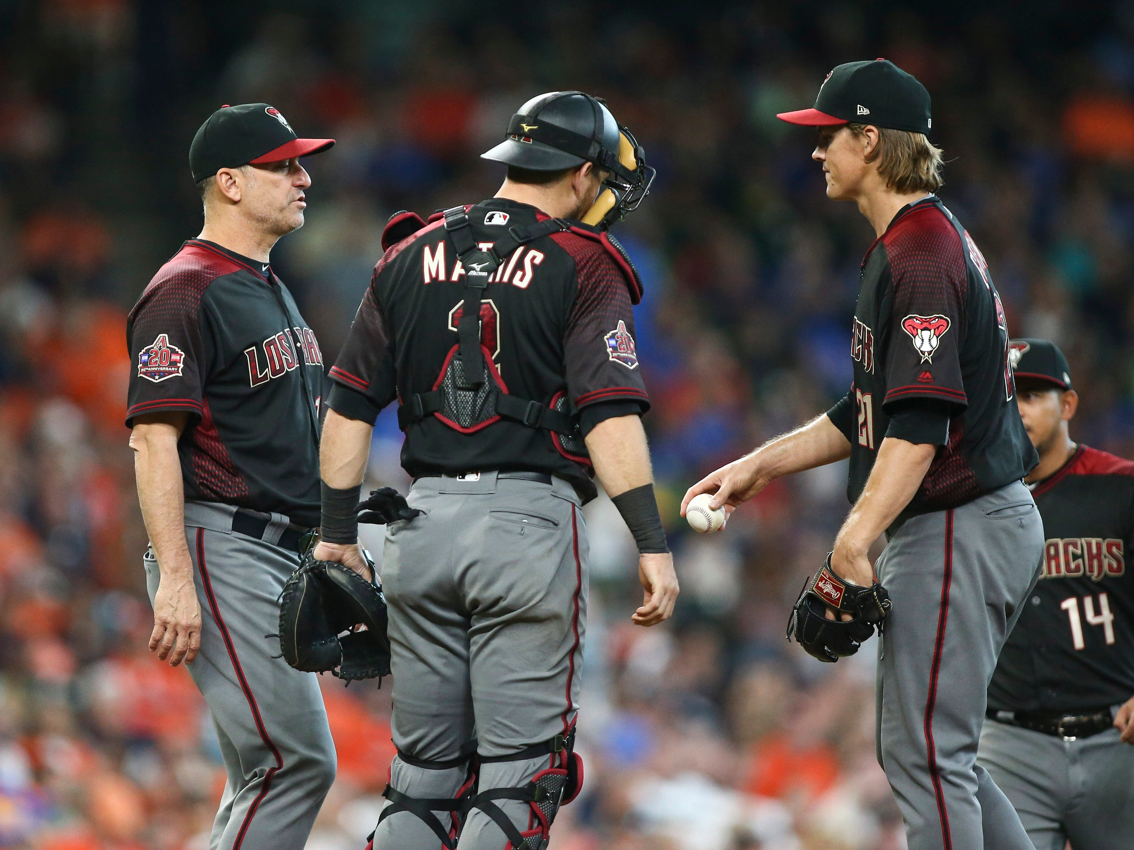 Sep 16, 2018; Houston, TX, USA; Arizona Diamondbacks starting pitcher Zack Greinke (21) gives the ball to manager Torey Lovullo (left) during a pitching change in the seventh inning against the Houston Astros at Minute Maid Park. Mandatory Credit: Troy Taormina-USA TODAY Sports