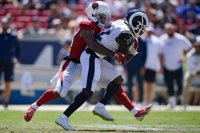Sep 16, 2018; Los Angeles, CA, USA; Los Angeles Rams wide receiver Brandin Cooks (12) runs after the catch while Arizona Cardinals cornerback Jamar Taylor (28) attempts a tackle during the first half at Los Angeles Memorial Coliseum. Mandatory Credit: Kelvin Kuo-USA TODAY Sports