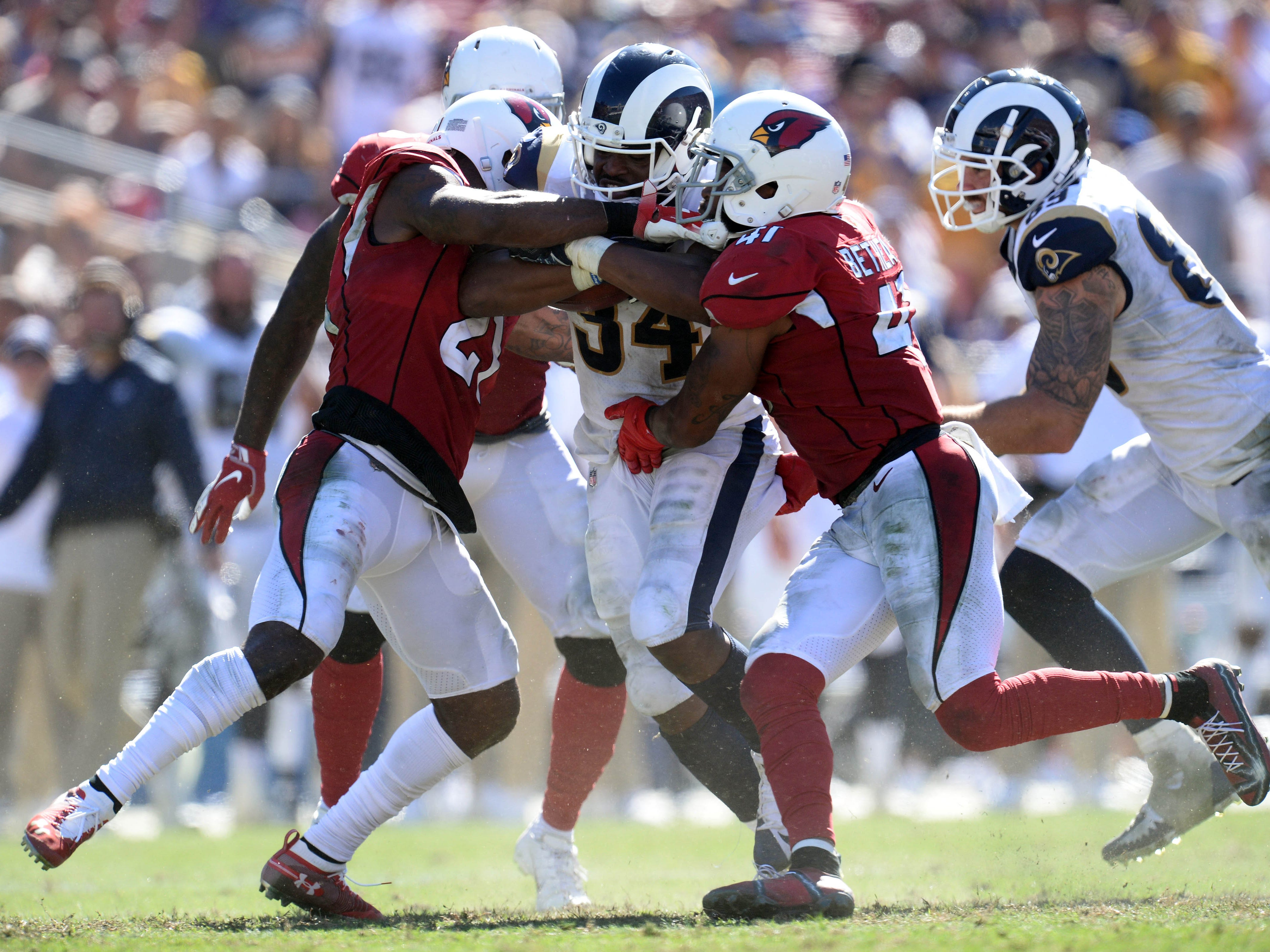 September 16, 2018; Los Angeles, CA, USA; Los Angeles Rams running back Malcolm Brown (34) runs the ball against the Arizona Cardinals during the second half at the Los Angeles Memorial Coliseum. Mandatory Credit: Gary A. Vasquez-USA TODAY Sports