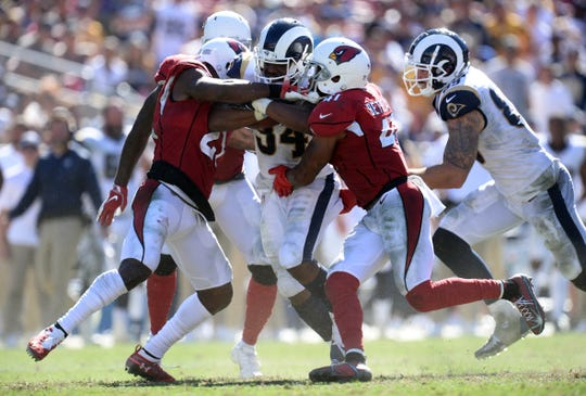 Rams running back Malcolm Brown is swallowed up by the Cardinals' defense during a game on Sept. 16.