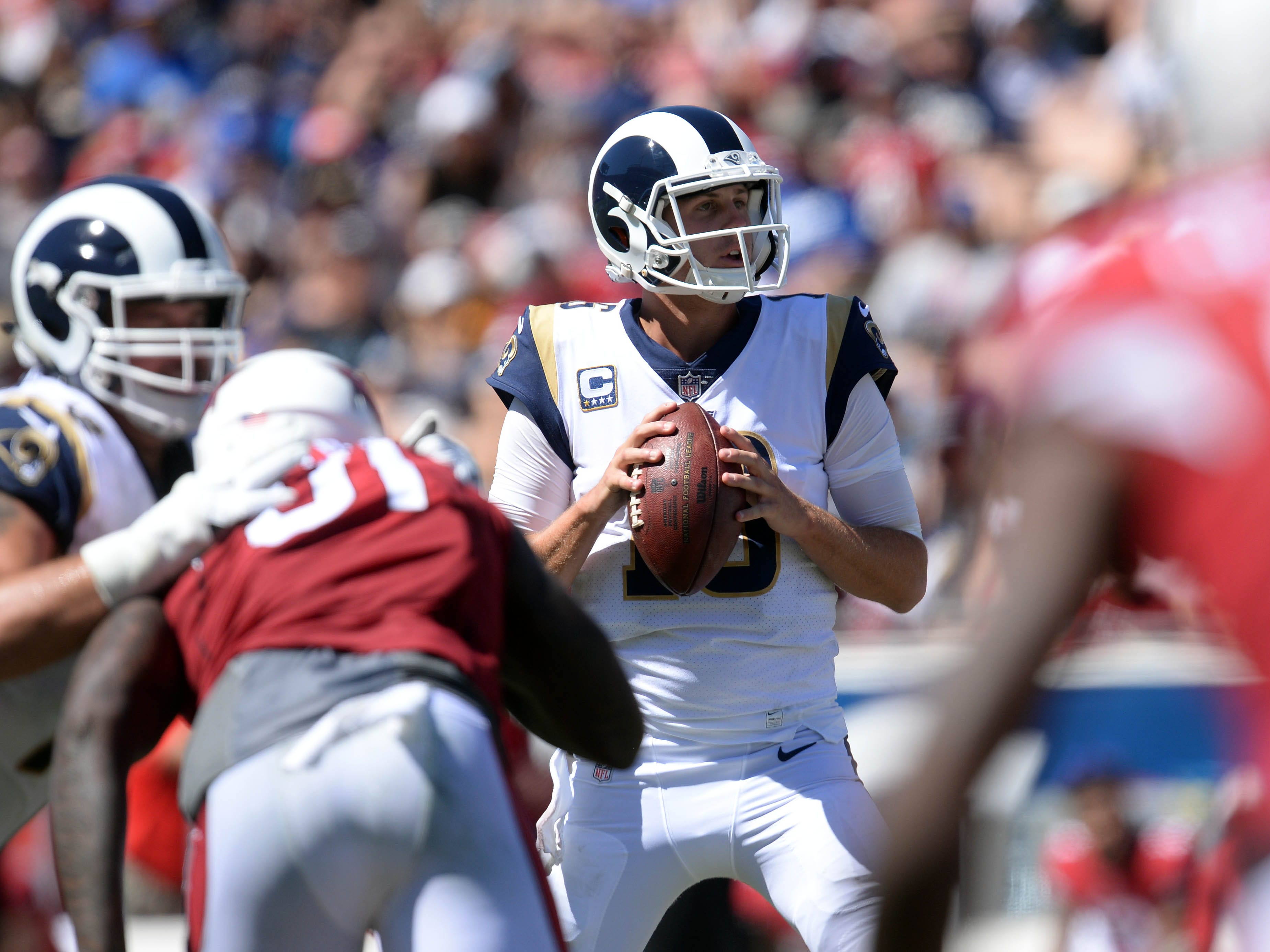 September 16, 2018; Los Angeles, CA, USA; Los Angeles Rams quarterback Jared Goff (16) drops back to pass against the Arizona Cardinals during the first half at the Los Angeles Memorial Coliseum. Mandatory Credit: Gary A. Vasquez-USA TODAY Sports