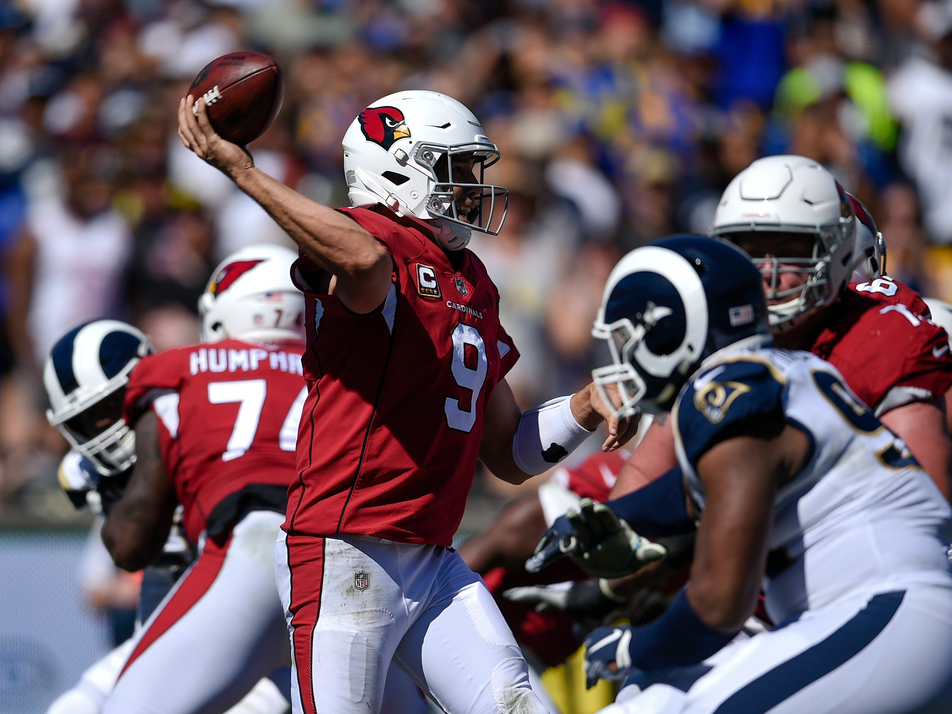 Sep 16, 2018; Los Angeles, CA, USA; Arizona Cardinals quarterback Sam Bradford (9) attempts a pass during the second half against the Los Angeles Rams at Los Angeles Memorial Coliseum. Mandatory Credit: Kelvin Kuo-USA TODAY Sports
