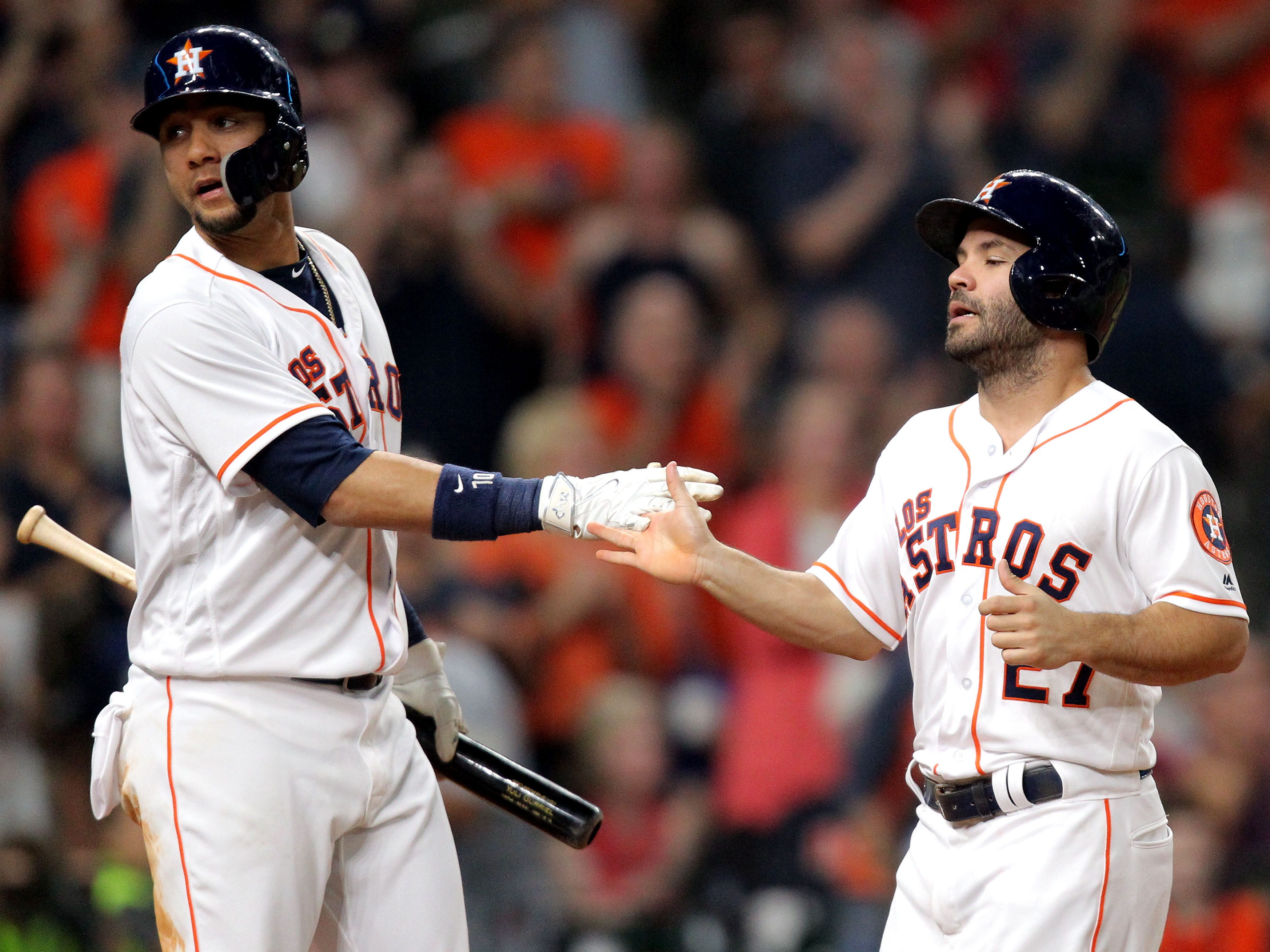 Sep 15, 2018; Houston, TX, USA; Houston Astros second baseman Jose Altuve (27, right) is congratulated by Houston Astros first baseman Yuli Gurriel (10) after scoring a run against the Arizona Diamondbacks during the fourth inning at Minute Maid Park. Mandatory Credit: Erik Williams-USA TODAY Sports
