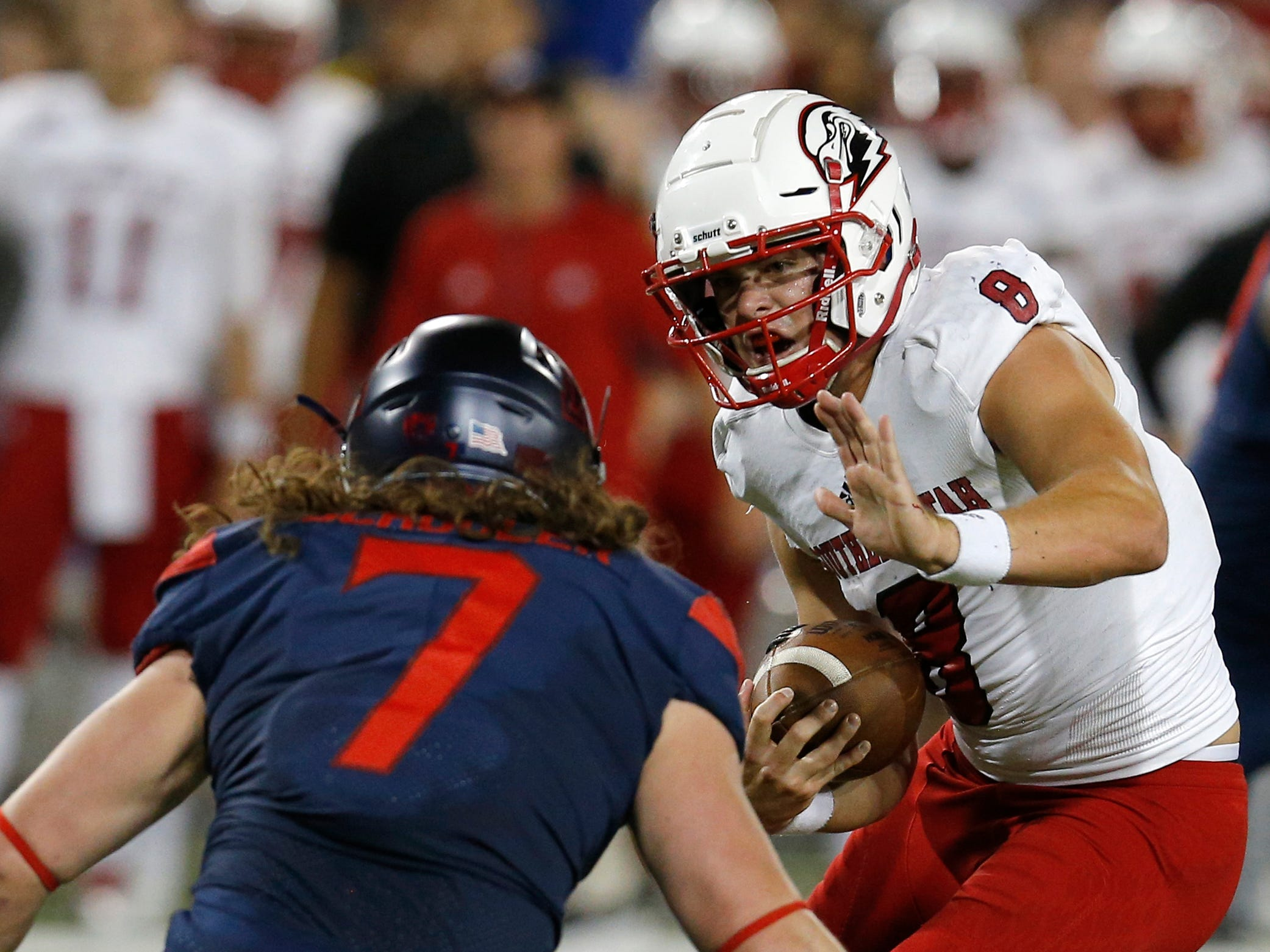 Southern Utah quarterback Chris Helbig (8) stiff-arms Arizona linebacker Colin Schooler in the first half during an NCAA college football game, Saturday, Sept. 15, 2018, in Tucson, Ariz. (AP Photo/Rick Scuteri)