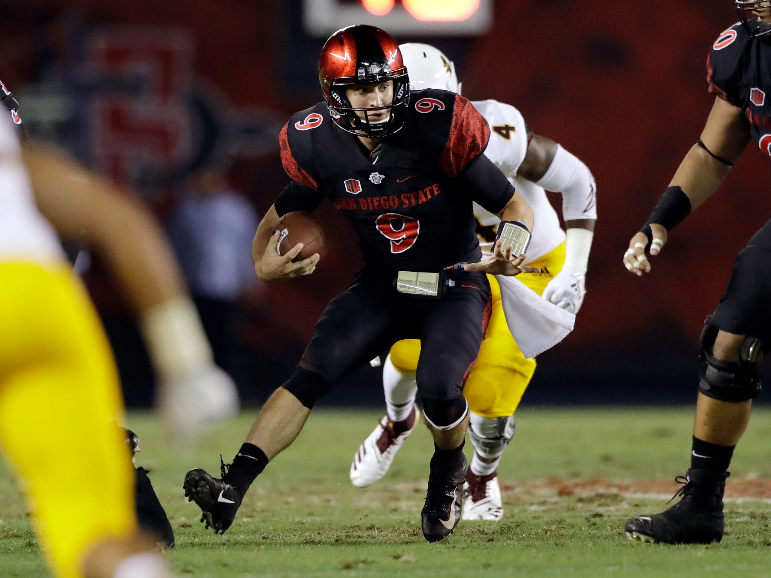 San Diego State quarterback Ryan Agnew runs with the ball during the first half of an NCAA college football game against Arizona State, Saturday, Sept. 15, 2018, in San Diego. (AP Photo/Gregory Bull)