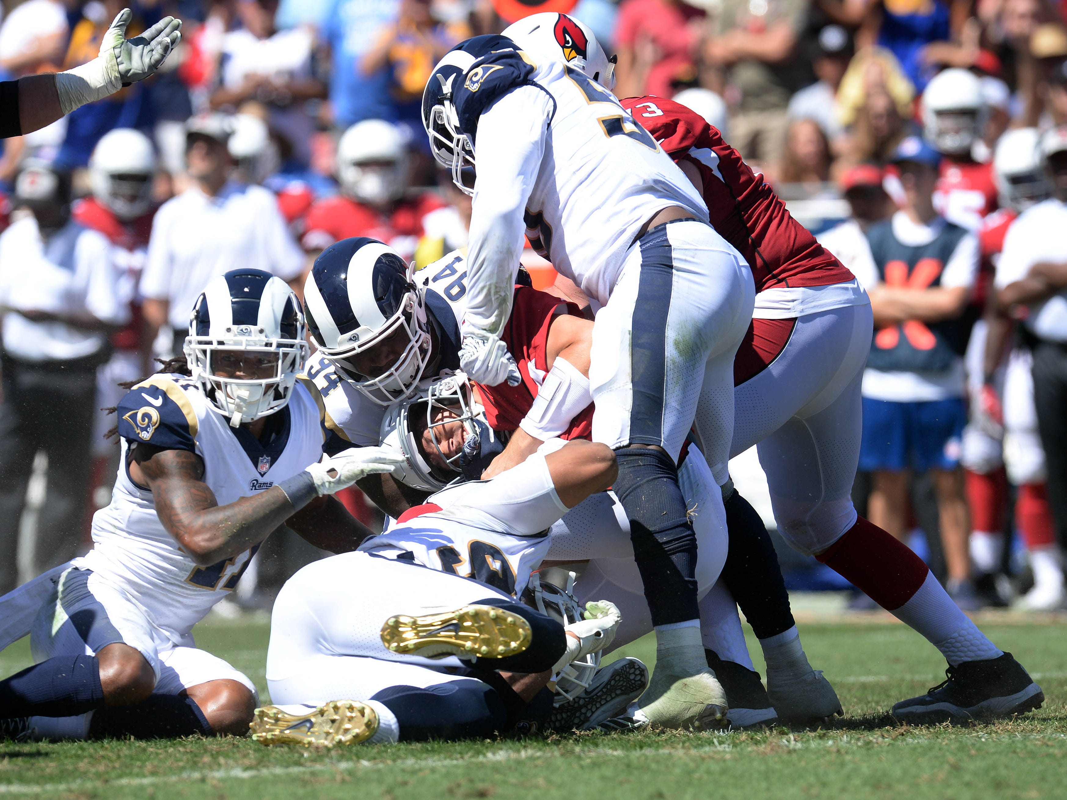 September 16, 2018; Los Angeles, CA, USA; Arizona Cardinals quarterback Sam Bradford (9) is brought down by the Los Angeles Rams defense during the first half at the Los Angeles Memorial Coliseum. Mandatory Credit: Gary A. Vasquez-USA TODAY Sports