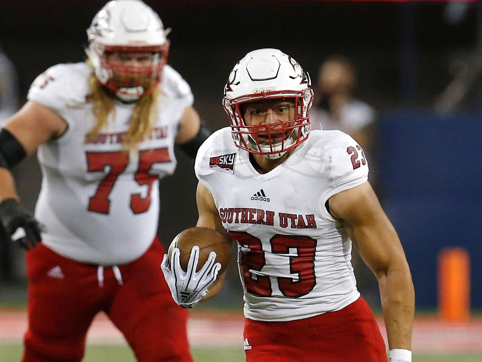 Southern Utah running back James Felila (23) in the first half during an NCAA college football game against Arizona, Saturday, Sept. 15, 2018, in Tucson, Ariz. (AP Photo/Rick Scuteri)