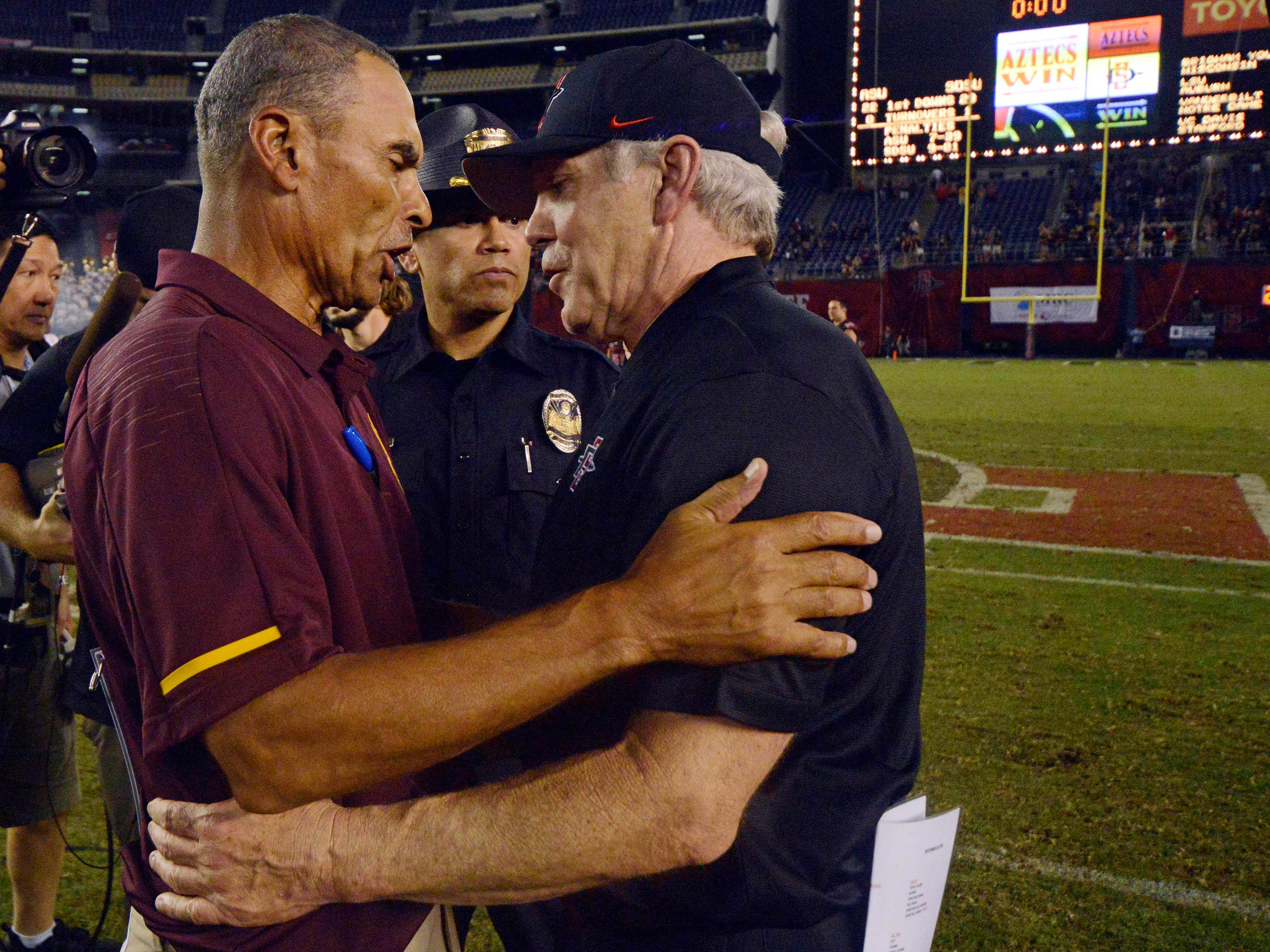 Sep 15, 2018; San Diego, CA, USA; Arizona State Sun Devils head coach Herm Edwards (left) and San Diego State Aztecs head coach Rocky Long talk after a 28-21 win for the Aztecs at SDCCU Stadium. Mandatory Credit: Jake Roth-USA TODAY Sports