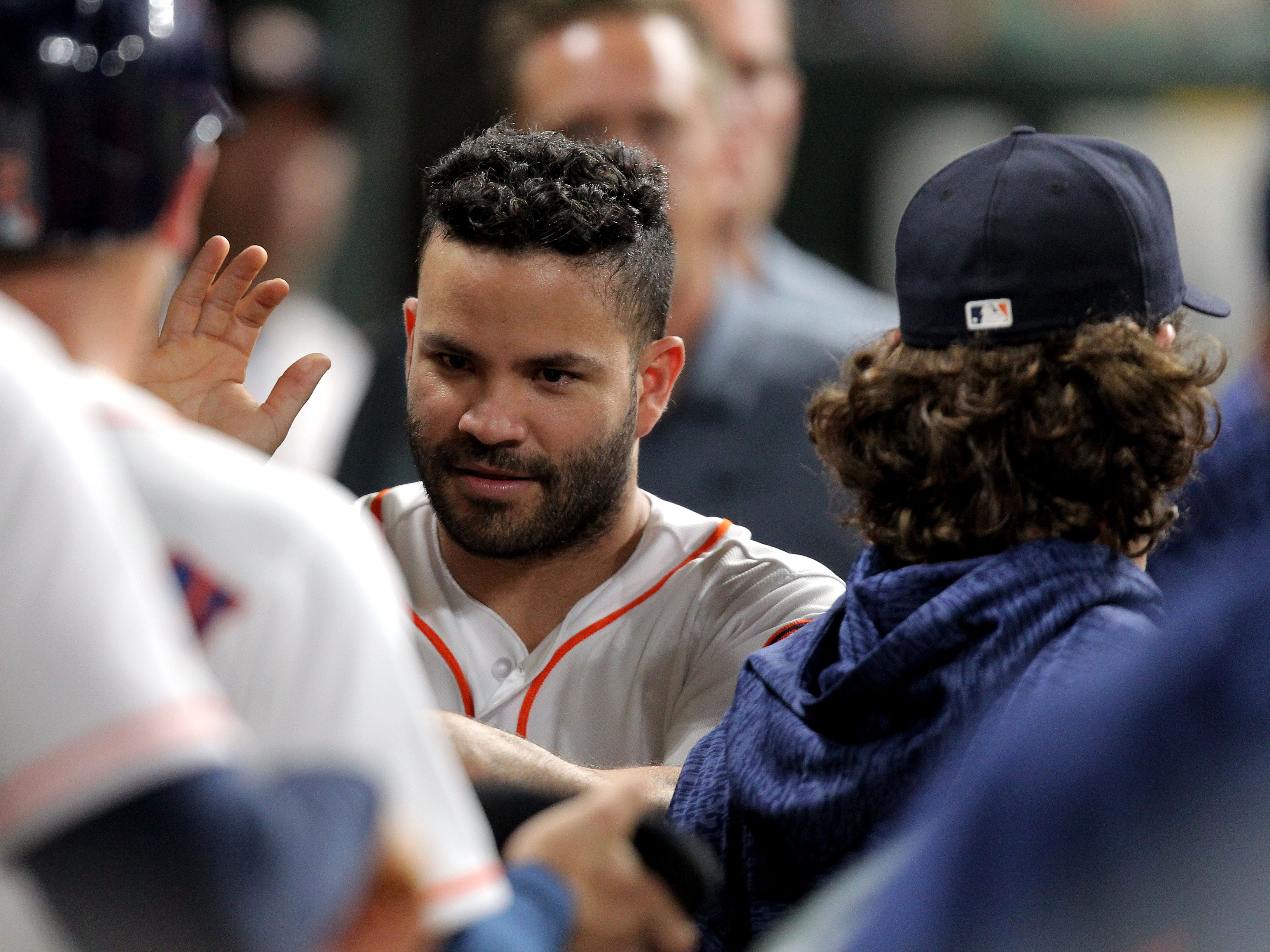 Sep 15, 2018; Houston, TX, USA; Houston Astros second baseman Jose Altuve (27) is greeted in the dugout after scoring a run against the Arizona Diamondbacks during the sixth inning at Minute Maid Park. Mandatory Credit: Erik Williams-USA TODAY Sports