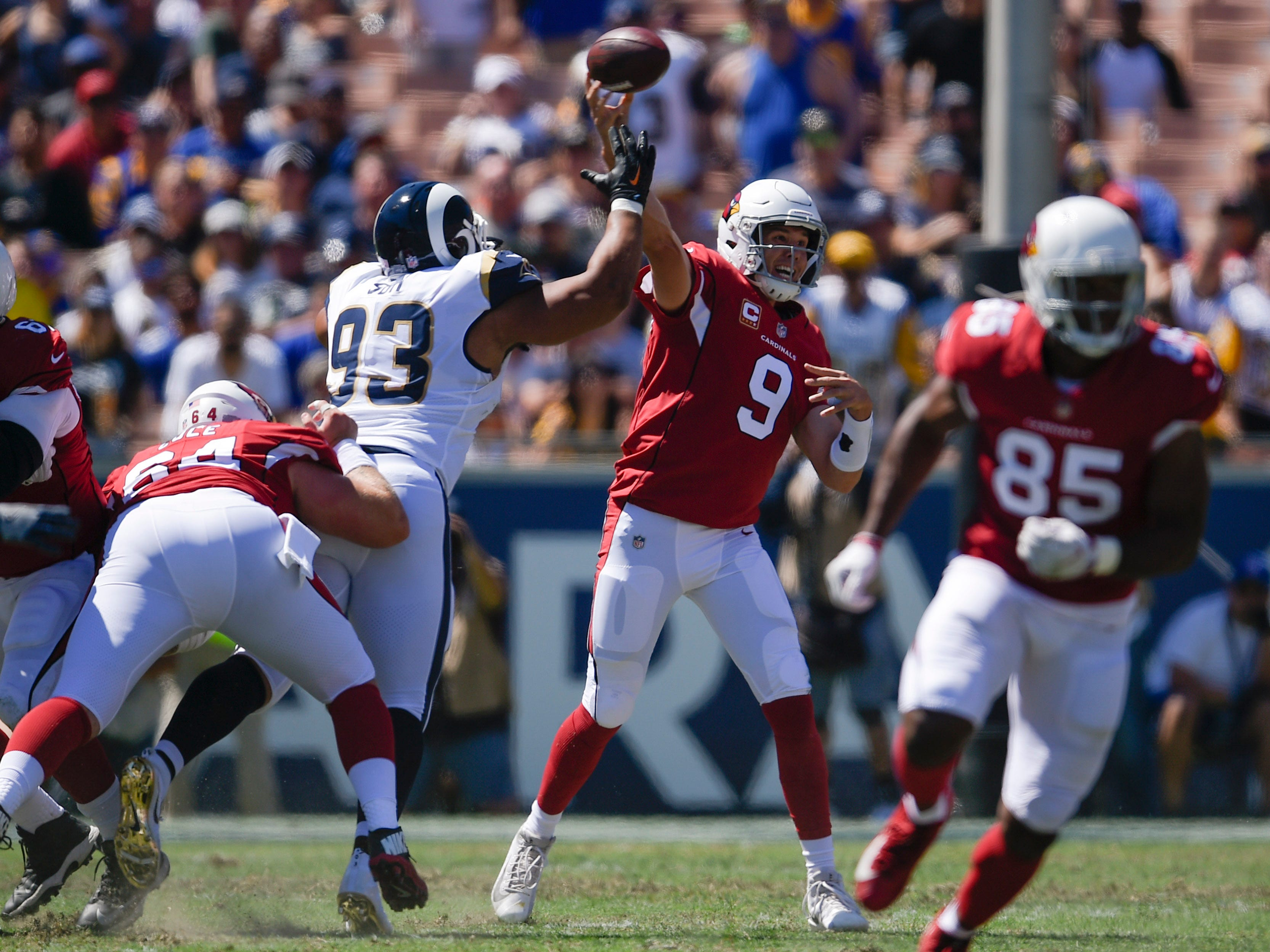 Sep 16, 2018; Los Angeles, CA, USA; Arizona Cardinals quarterback Sam Bradford (9) attempts a [ass while under pressure by Los Angeles Rams defensive tackle Ndamukong Suh (93) during the first half at Los Angeles Memorial Coliseum. Mandatory Credit: Kelvin Kuo-USA TODAY Sports