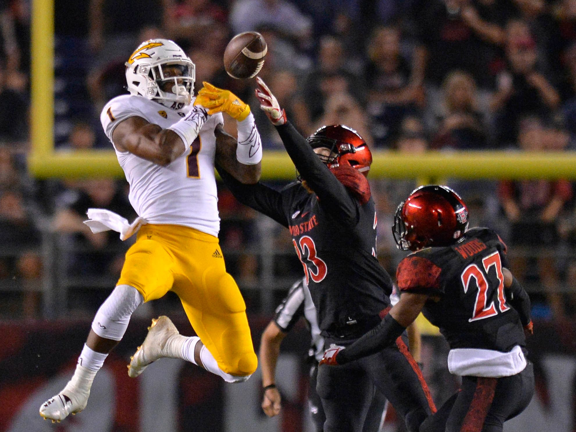 Sep 15, 2018; San Diego, CA, USA; Arizona State Sun Devils wide receiver N'Keal Harry (1) cannot make a catch as San Diego State Aztecs safety Parker Baldwin (33) and cornerback Kyree Woods (27) defend during the fourth quarter at SDCCU Stadium. Mandatory Credit: Jake Roth-USA TODAY Sports