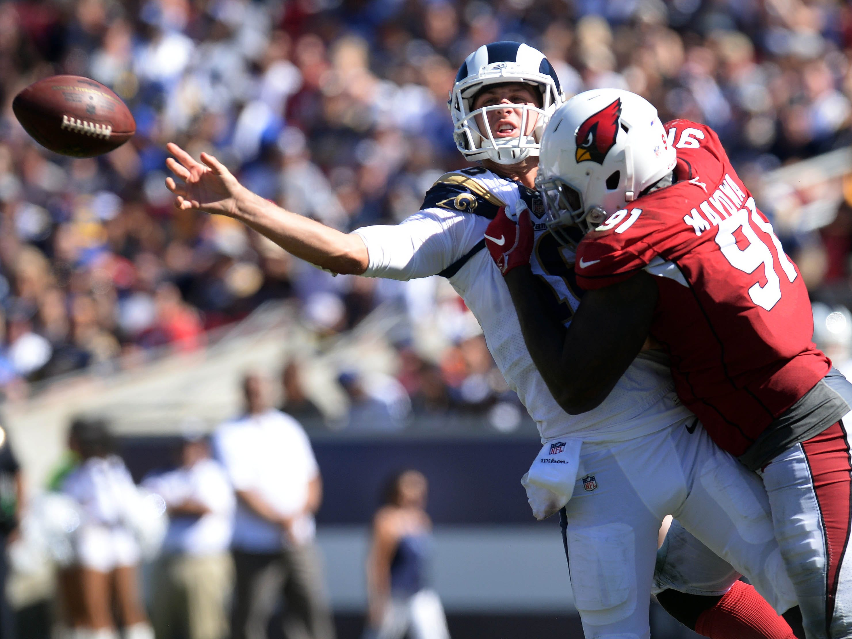 September 16, 2018; Los Angeles, CA, USA; Los Angeles Rams quarterback Jared Goff (16) throws under pressure against Arizona Cardinals defensive end Benson Mayowa (91) during the second half at the Los Angeles Memorial Coliseum. Mandatory Credit: Gary A. Vasquez-USA TODAY Sports