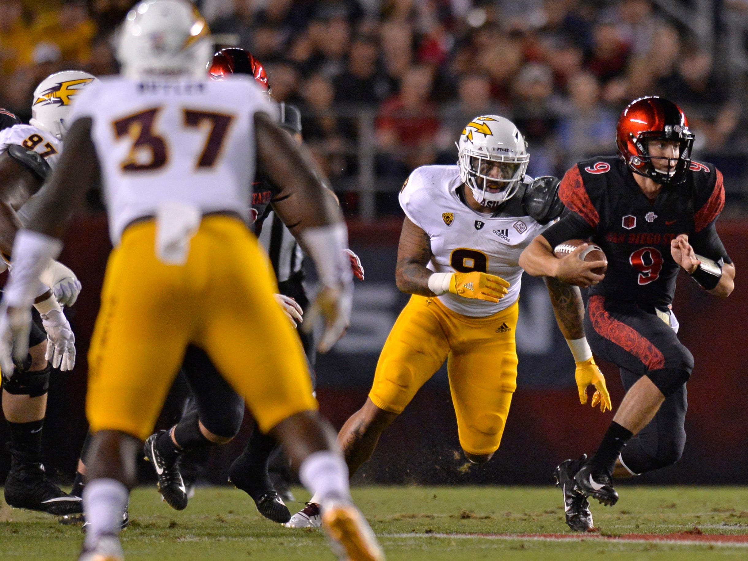 Sep 15, 2018; San Diego, CA, USA; San Diego State Aztecs quarterback Ryan Agnew (right) is chased by Arizona State Sun Devils linebacker Jay Jay Wilson (9) during the first quarter at SDCCU Stadium. Mandatory Credit: Jake Roth-USA TODAY Sports