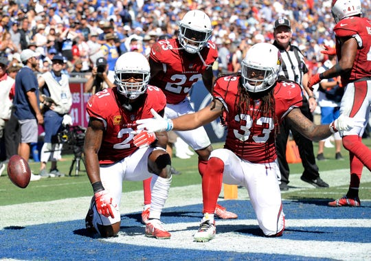 September 16, 2018; Los Angeles, CA, USA; Arizona Cardinals defensive back Tre Boston (33) defensive back Bene' Benwikere (23) pose for a photo in celebration of defensive back Patrick Peterson (21) interception against Los Angeles Rams quarterback Jared Goff (16) during the second half at the Los Angeles Memorial Coliseum. Mandatory Credit: Gary A. Vasquez-USA TODAY Sports