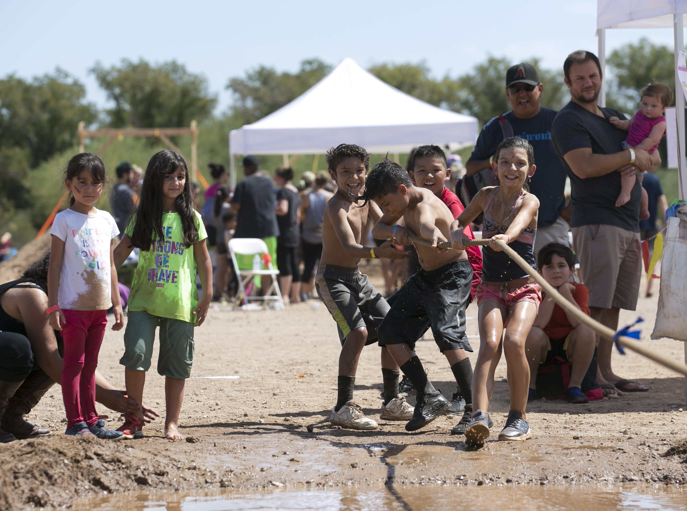 Kids play tug-of-war at the third annual Messy Fest in Queen Creek on Saturday, Sept. 15, 2018.