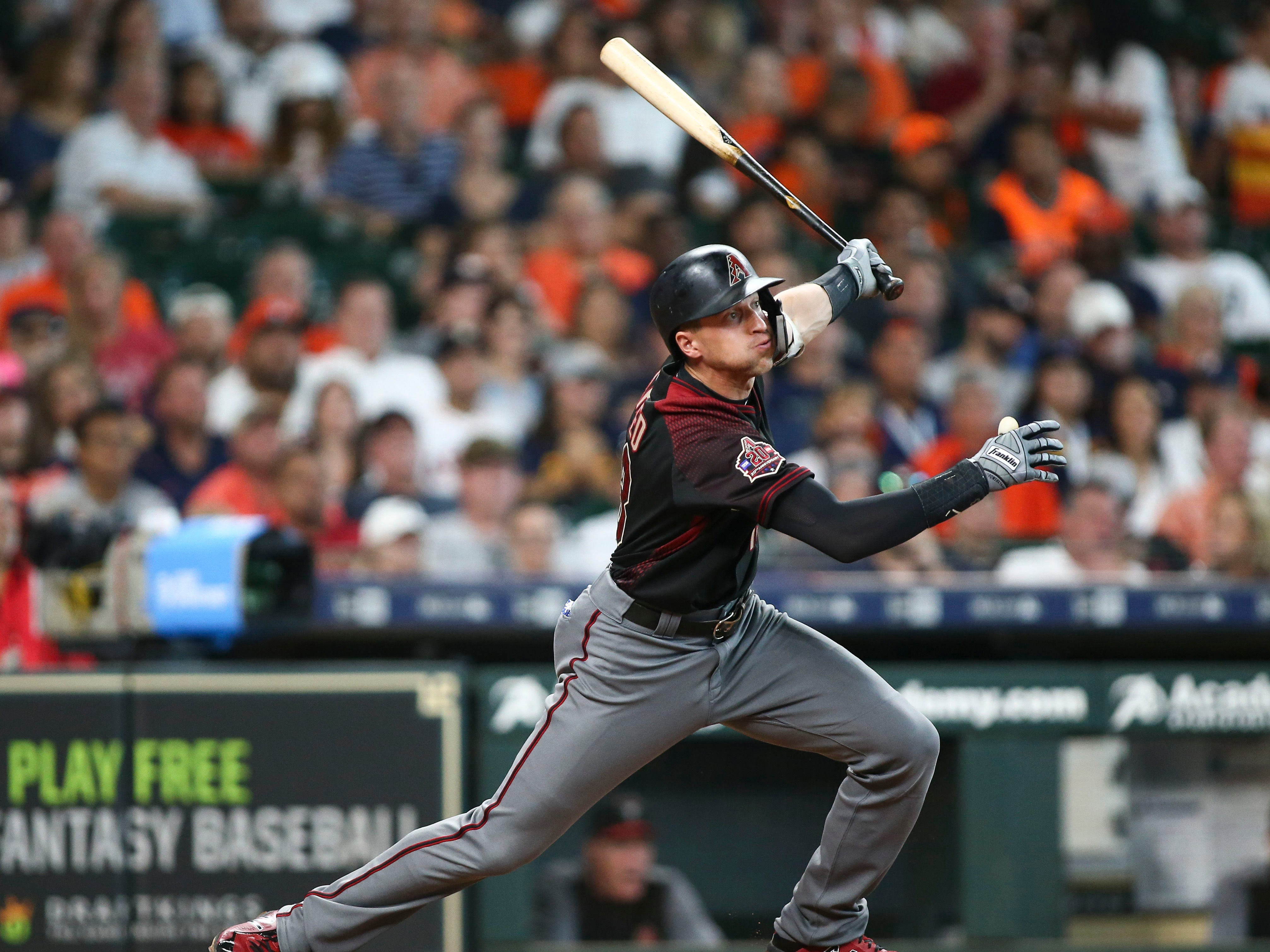 Sep 16, 2018; Houston, TX, USA; Arizona Diamondbacks shortstop Nick Ahmed (13) hits a single during the third inning against the Houston Astros at Minute Maid Park. Mandatory Credit: Troy Taormina-USA TODAY Sports