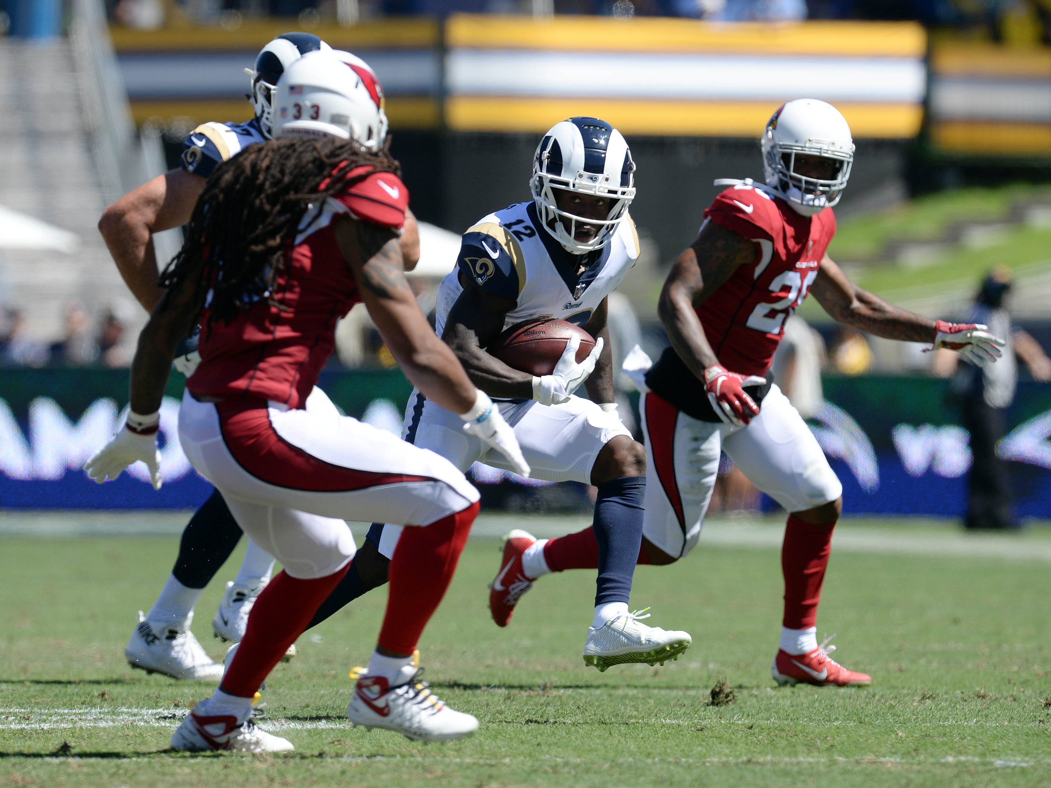 September 16, 2018; Los Angeles, CA, USA; Los Angeles Rams wide receiver Brandin Cooks (12) runs the ball against the Arizona Cardinals during the first half at the Los Angeles Memorial Coliseum. Mandatory Credit: Gary A. Vasquez-USA TODAY Sports