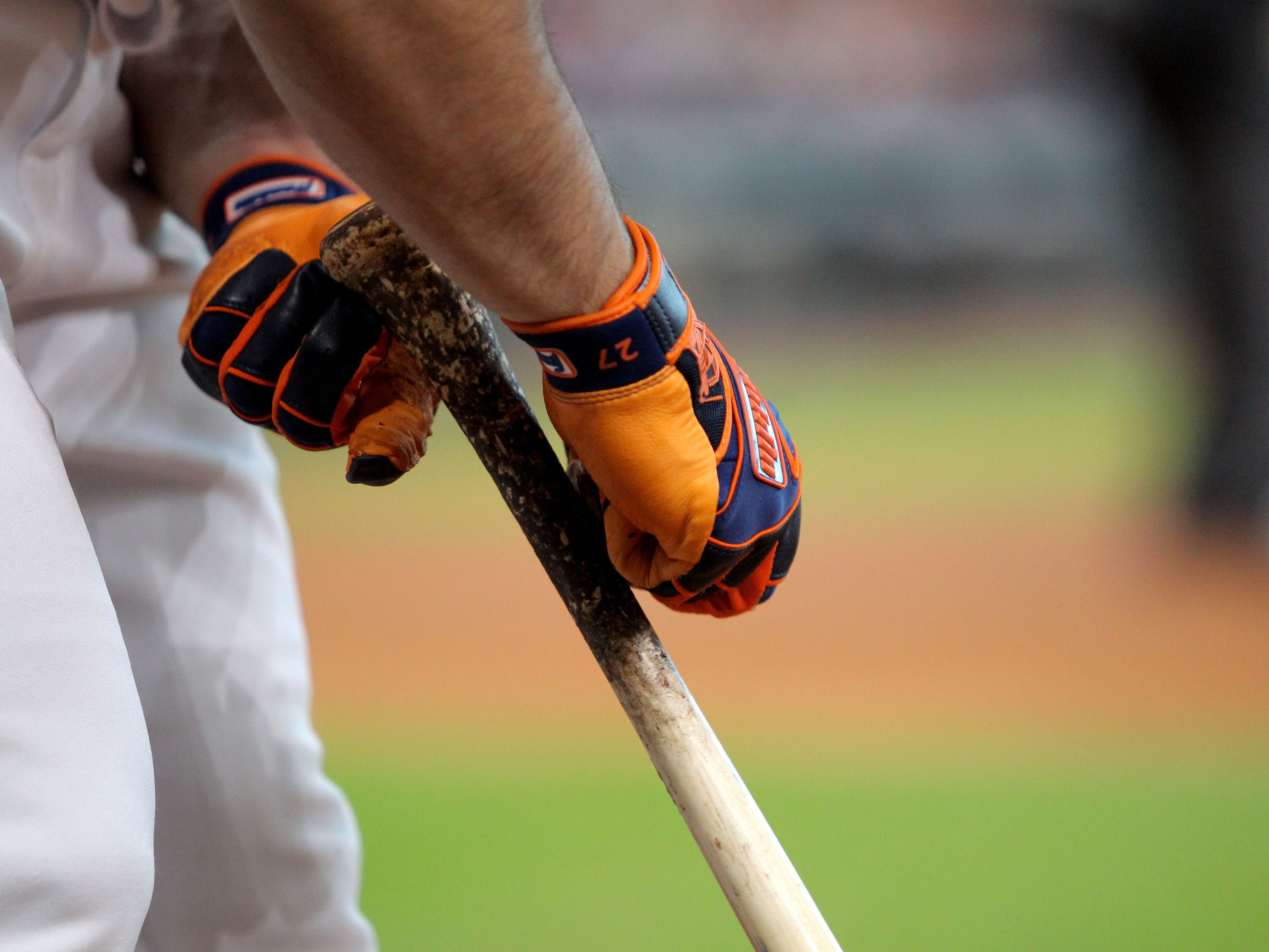 Sep 15, 2018; Houston, TX, USA; Houston Astros second baseman Jose Altuve (27) tends to his bat in the on-deck circle during the first inning against the Arizona Diamondbacks at Minute Maid Park. Mandatory Credit: Erik Williams-USA TODAY Sports