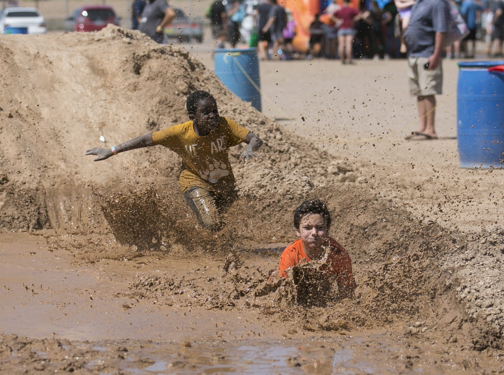 10-year-old Joshua Mwika (left) races 10-year-old Luke Geoles Hensey (right) at the third annual Messy Fest in Queen Creek on Saturday, Sept. 15, 2018.