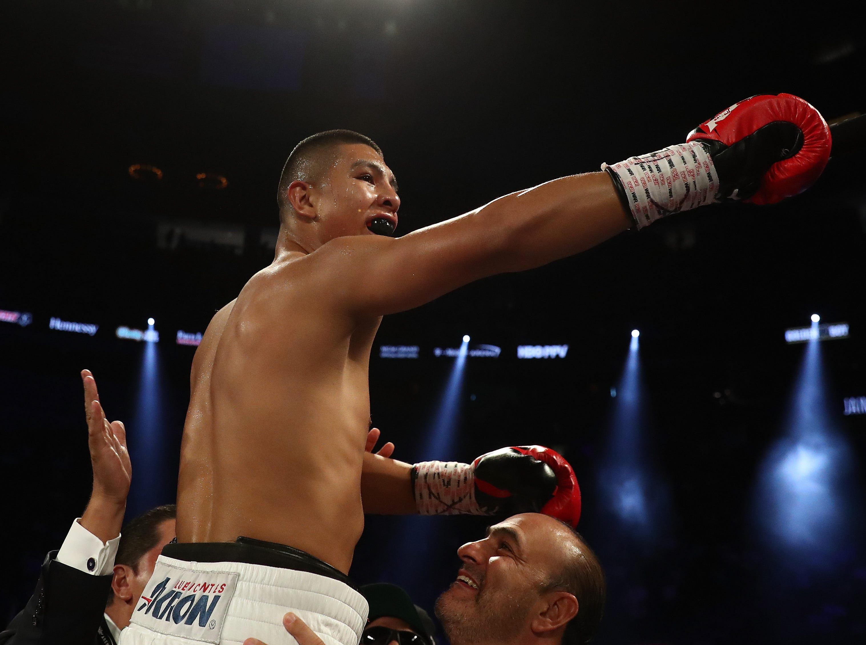 LAS VEGAS, NV - SEPTEMBER 15:  Jaime Munguia celebrates his tgird round TKO against Brandon Cook during their WBO junior middleweight title fight  at T-Mobile Arena on September 15, 2018 in Las Vegas, Nevada.  (Photo by Al Bello/Getty Images)