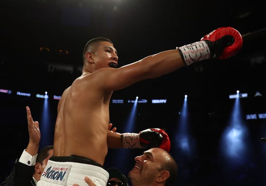 Jaime Munguia celebrates his third-round TKO against Brandon Cook during their WBO junior middleweight title fight at T-Mobile Arena on Sept. 15, 2018, in Las Vegas.