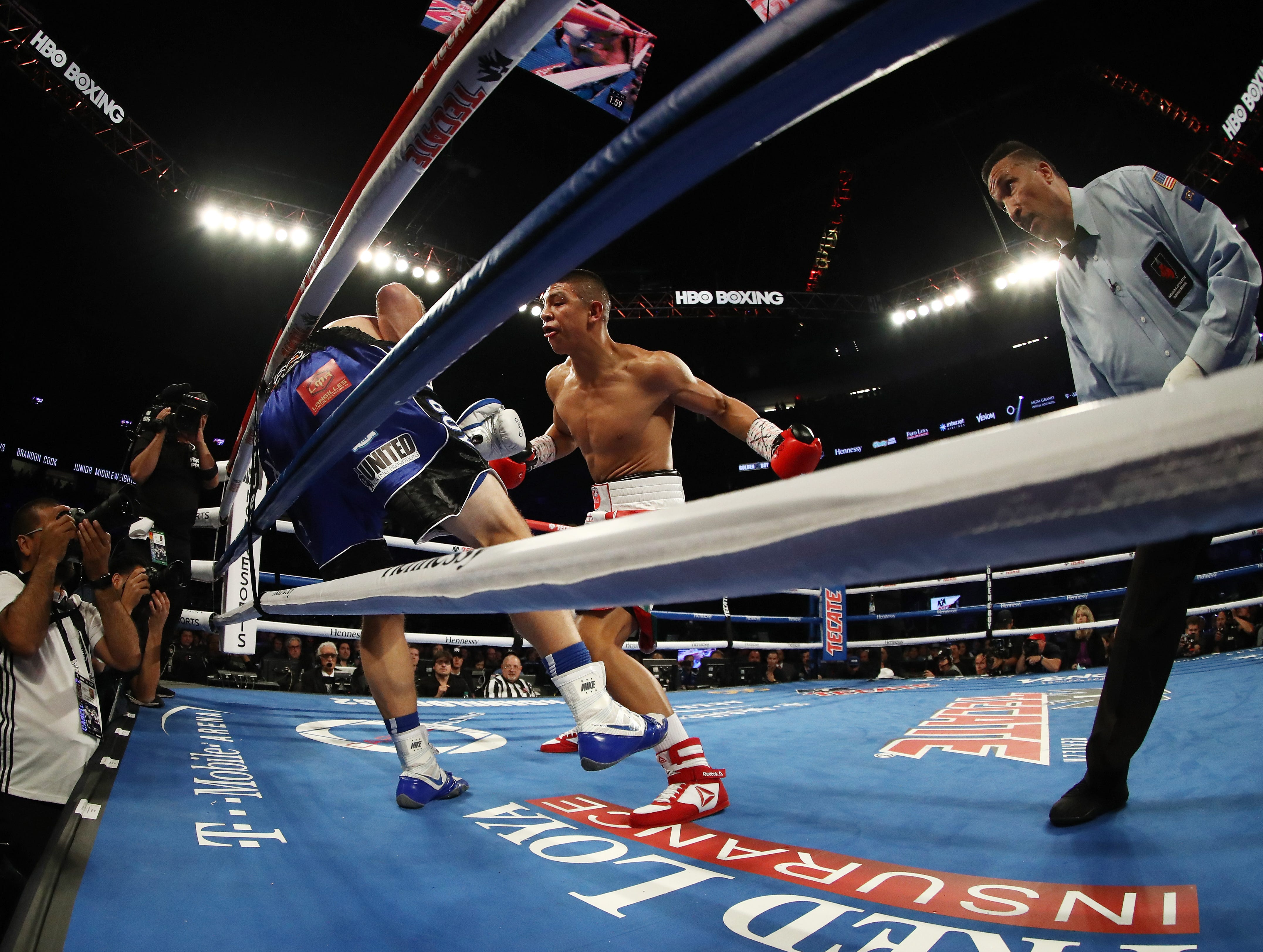 LAS VEGAS, NV - SEPTEMBER 15:  Referee Tony Weeks stops the fight in the third round as Jaime Munguia TKO's Brandon Cook during their WBO junior middleweight title fight  at T-Mobile Arena on September 15, 2018 in Las Vegas, Nevada.  (Photo by Al Bello/Getty Images)