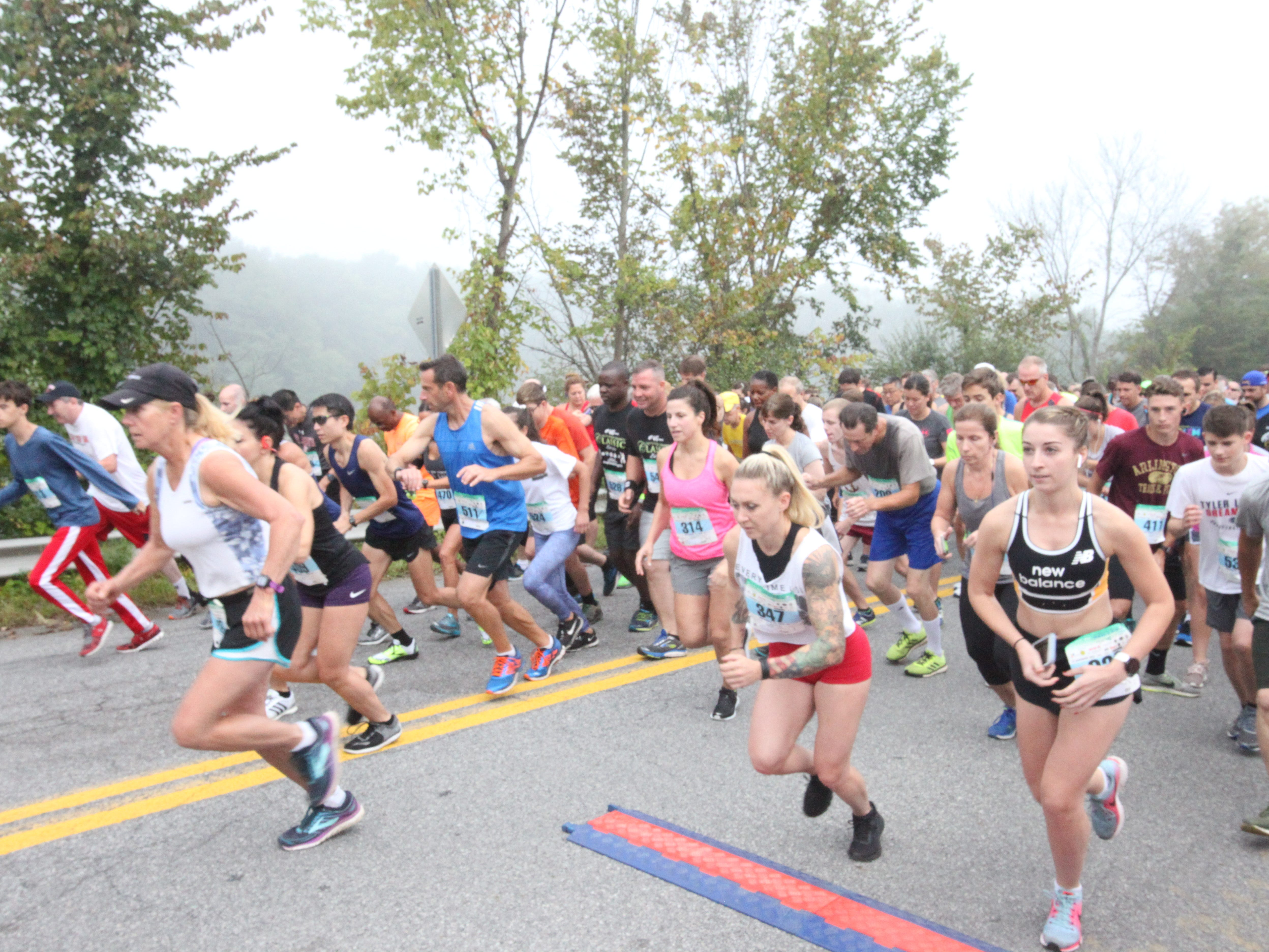 Runners begin the half marathon of the Dutchess County Classic in LaGrange on Sunday.