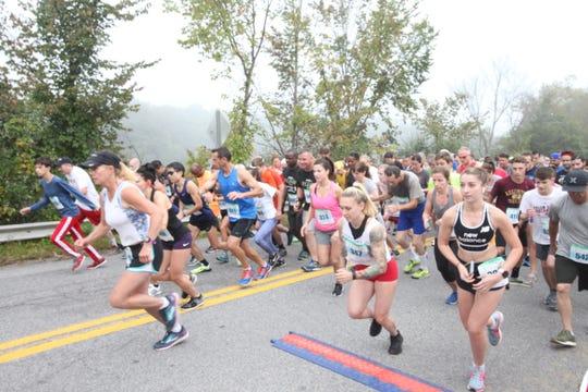 Runners begin the half marathon of the Dutchess County Classic in LaGrange on Sunday.