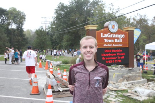 Hopewell Junction's Carter Somme, 18, poses after taking third in the men's 5k at the Dutchess County Classic.