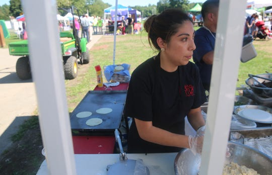 Ernestina Martinez, of La Charla Mexican Restaurant, takes a look at the crowd during Taste of New Paltz while rolling a fresh flour tortilla to be baked. She and her husband, Luis Martinez, both immigrated from Mexico and met in Poughkeepsie.
