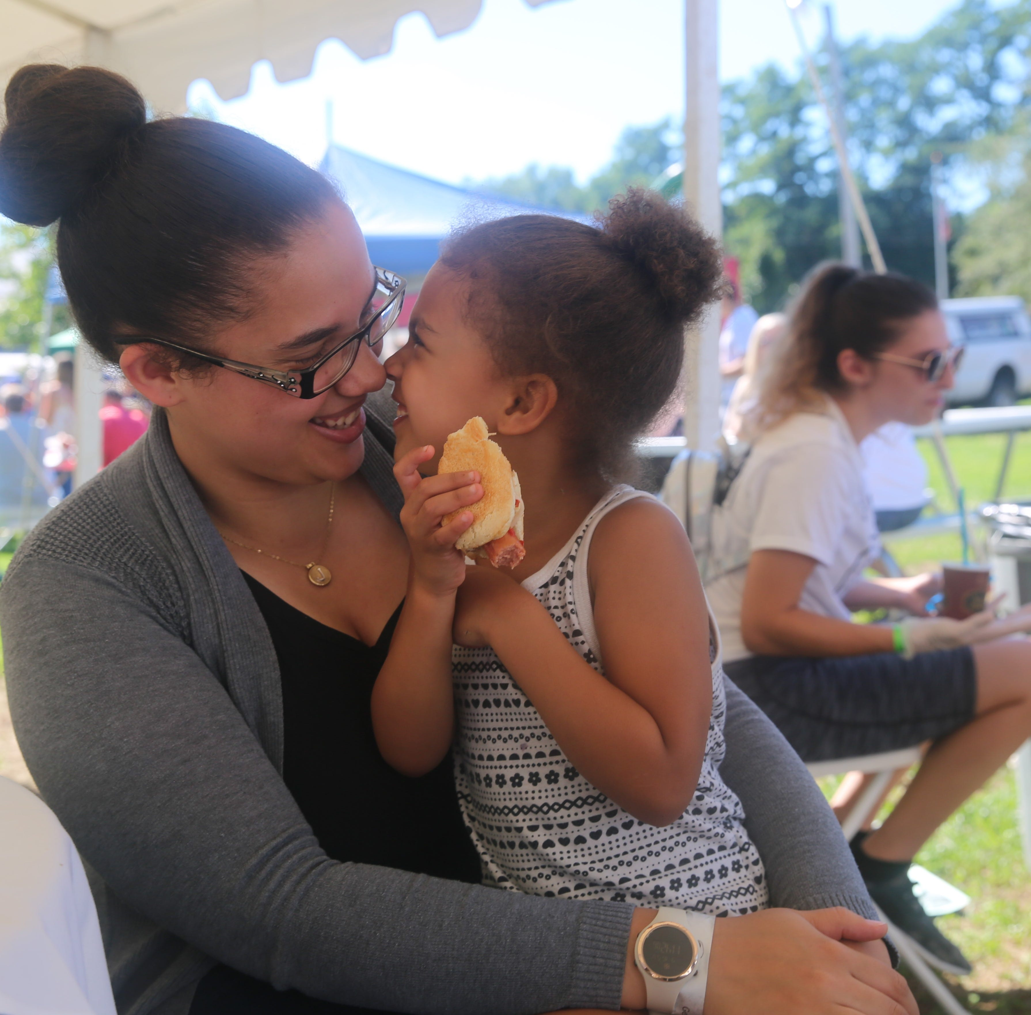 Jasmine Russell, of Monticello, shares a moment with her 4-year-old daughter, Amelia, during A Taste of New Paltz on Sunday. She said she wanted to find out about some new restaurants to potentially try.