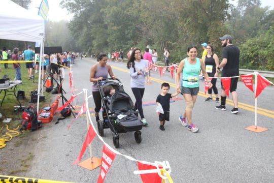 The Garcia family of Pawling crosses the finish line of the 1-mile kids race at the Dutchess County Classic.
