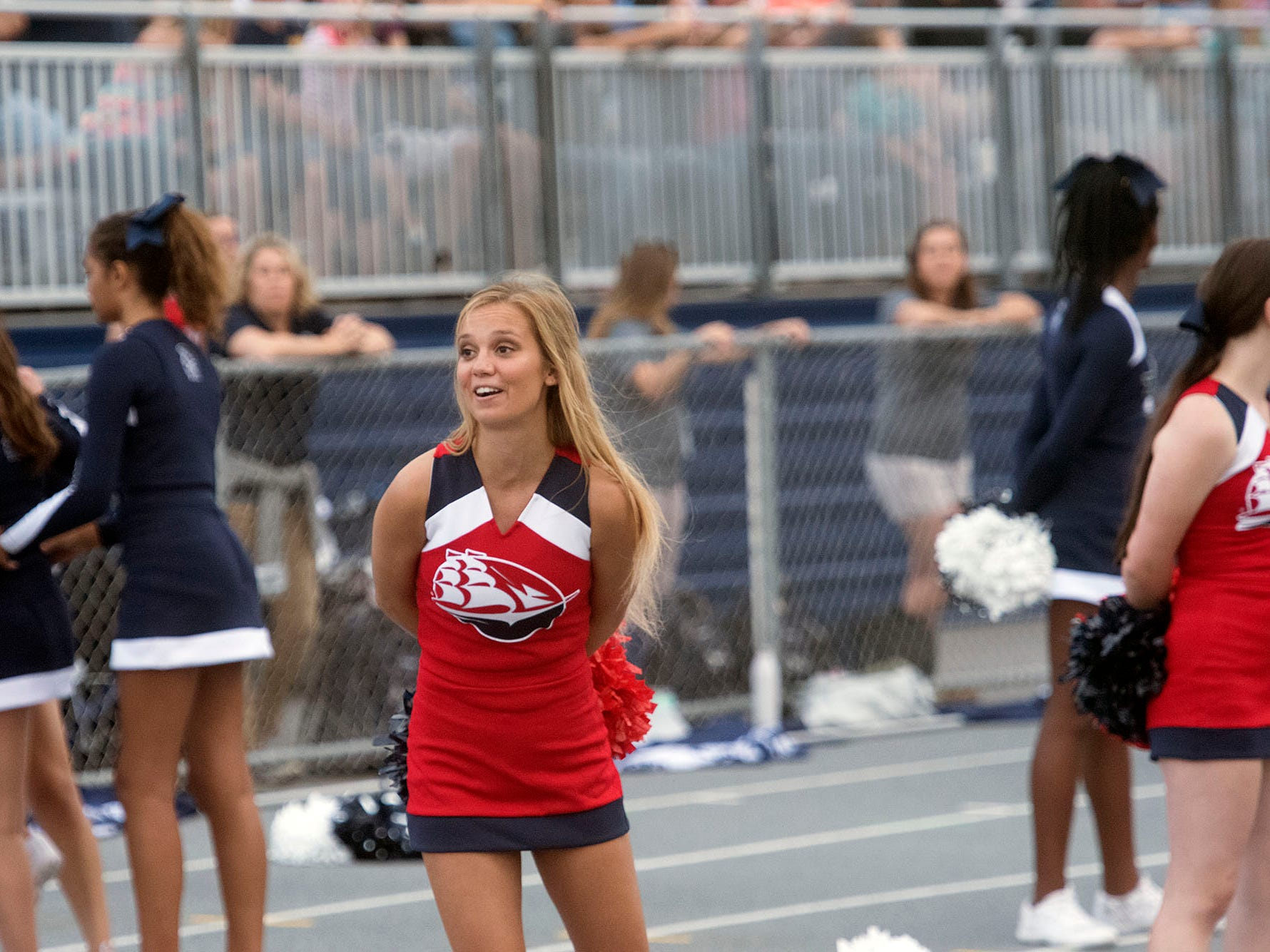 A Shippensburg University cheerleader joins Trojan cheerleaders for the South Western game. Chambersburg routed South Western 51-26 in football on Friday, Aug. 31, 2018.