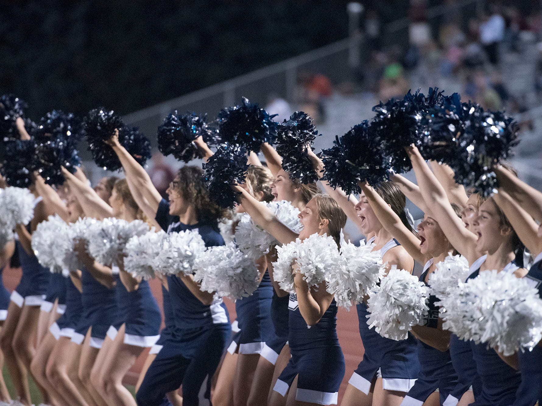 Chambersburg cheerleaders are pumped after a Trojan score. Chambersburg defeated Altoona in PIAA football to move to 4-0 on Friday, Sept. 14, 2018.