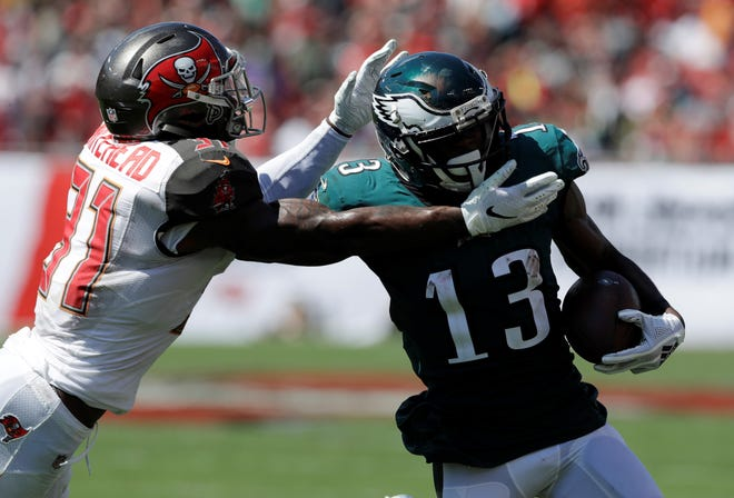 Tampa Bay Buccaneers defensive back Jordan Whitehead (31) attempts to tackle Philadelphia Eagles wide receiver Nelson Agholor (13), during the second half of an NFL football game, Sunday, Sept. 16, 2018, in Tampa, Fla. (AP Photo/Chris O'Meara)