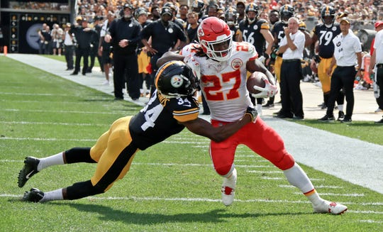 Kansas City Chiefs running back Kareem Hunt (27) gets away from Pittsburgh Steelers defensive back Terrell Edmunds (34) for a touchdown in the first half of an NFL football game against the Pittsburgh Steelers, Sunday, Sept. 16, 2018, in Pittsburgh. (AP Photo/Gene J. Puskar)