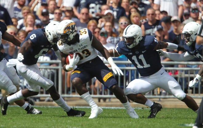 Linebackers Cam Brown (6) and Micah Parsons (11) tackle Kent State running back Jo-El Shaw. Penn State defeated Kent State 63-10 on Saturday, Sept. 15, 2018, at Beaver Stadium in University Park, Pennsylvania.