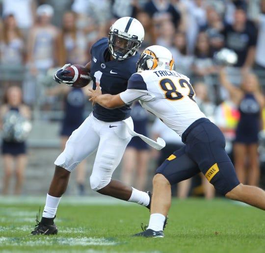 K.J. Hamler is tackled by kicker Matthew Trickett during the second half of Penn State's 63-10 win vs. Kent State on Saturday, Sept. 15, 2018, at Beaver Stadium in University Park, Pennsylvania.
