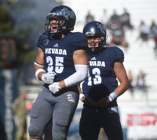 Nevada's Toa Taua (35) celebrates a first half touchdown against Oregon State during their football game at Mackay Stadium in Reno on Sept. 15, 2018.