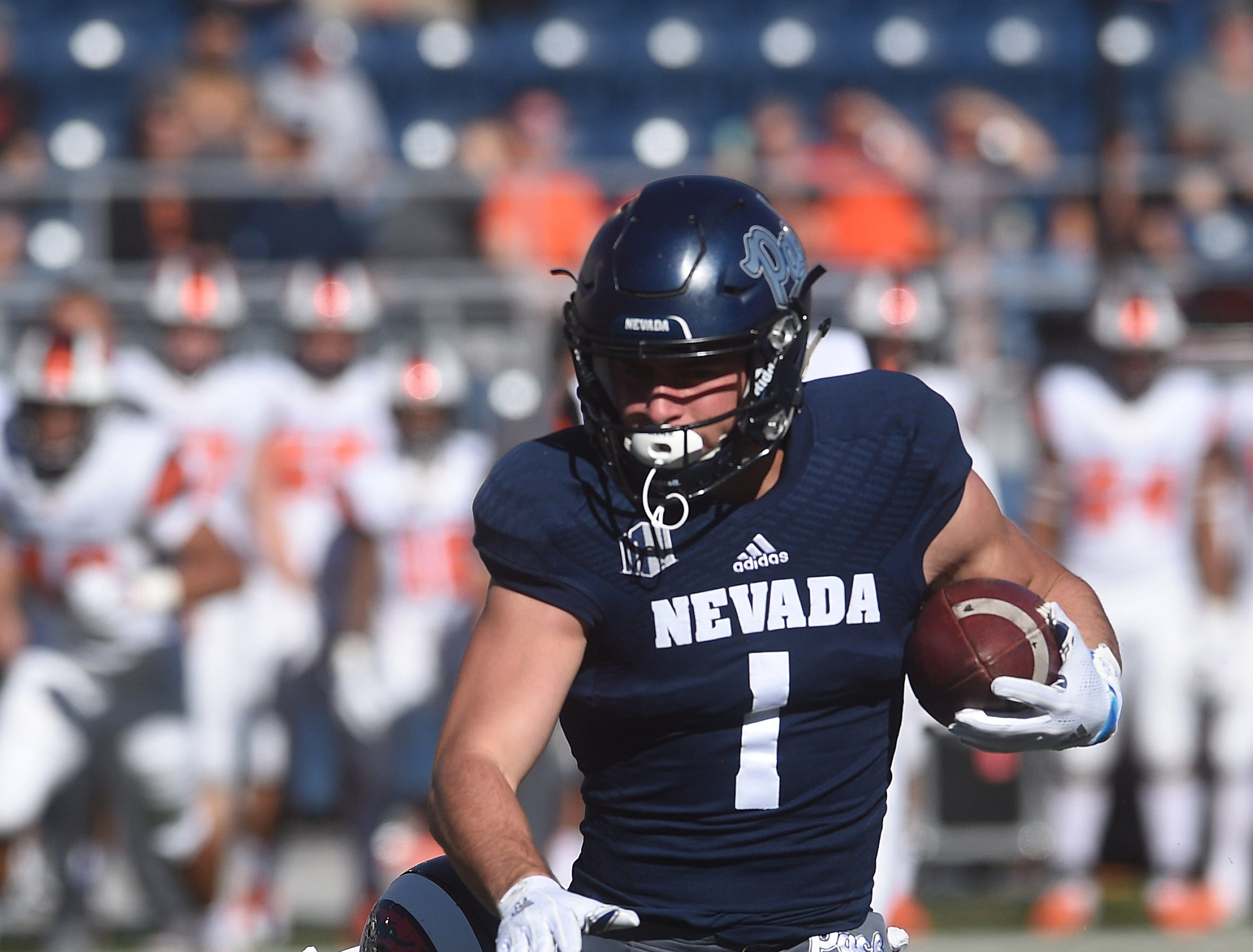 Nevada's McLane Mannix (1) runs with the ball against Oregon State during their football game at Mackay Stadium in Reno on Sept. 15, 2018.