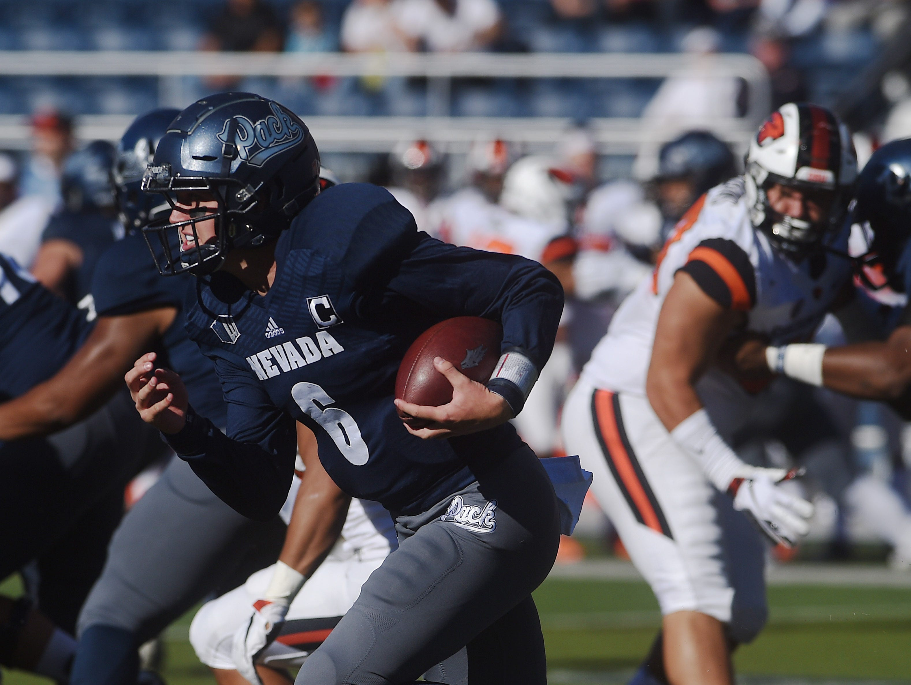 Nevada's Ty Gangi (6) looks for room to run while taking on Oregon State during their football game at Mackay Stadium in Reno on Sept. 15, 2018.