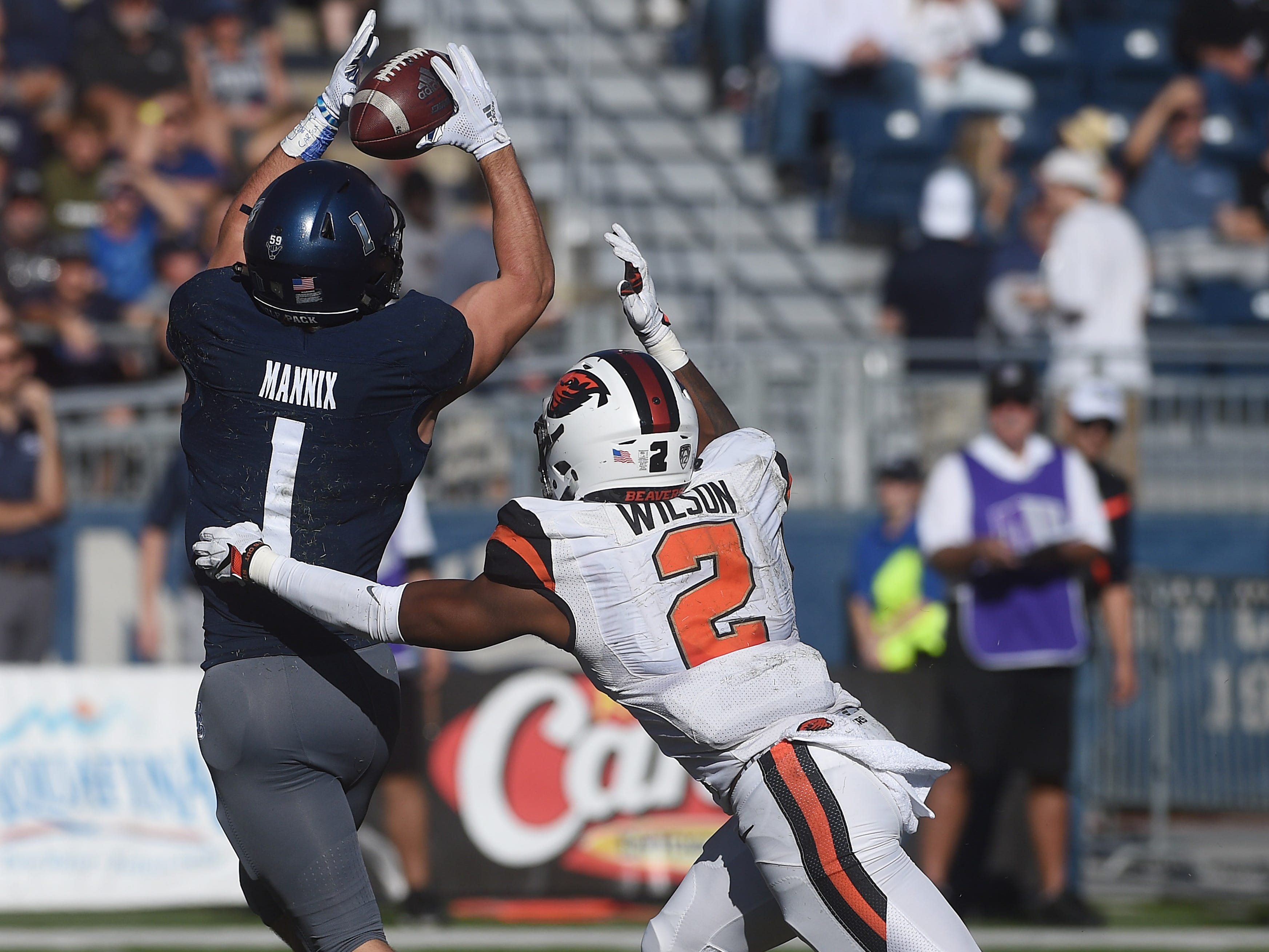 Nevada's McLane Mannix (1) catches a touchdown pass against Oregon State's Shawn Wilson during their football game at Mackay Stadium in Reno on Sept. 15, 2018.