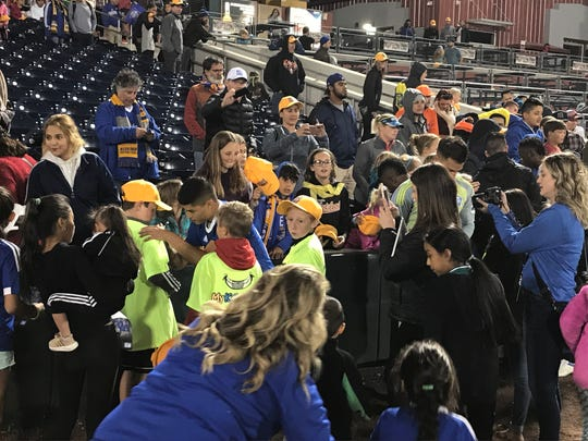Eric Calvillo signs autographs after Saturday's game.
