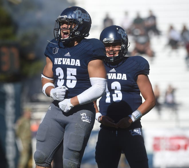 Nevada's Toa Taua (35) celebrates a first-half touchdown against Oregon State on Saturday.