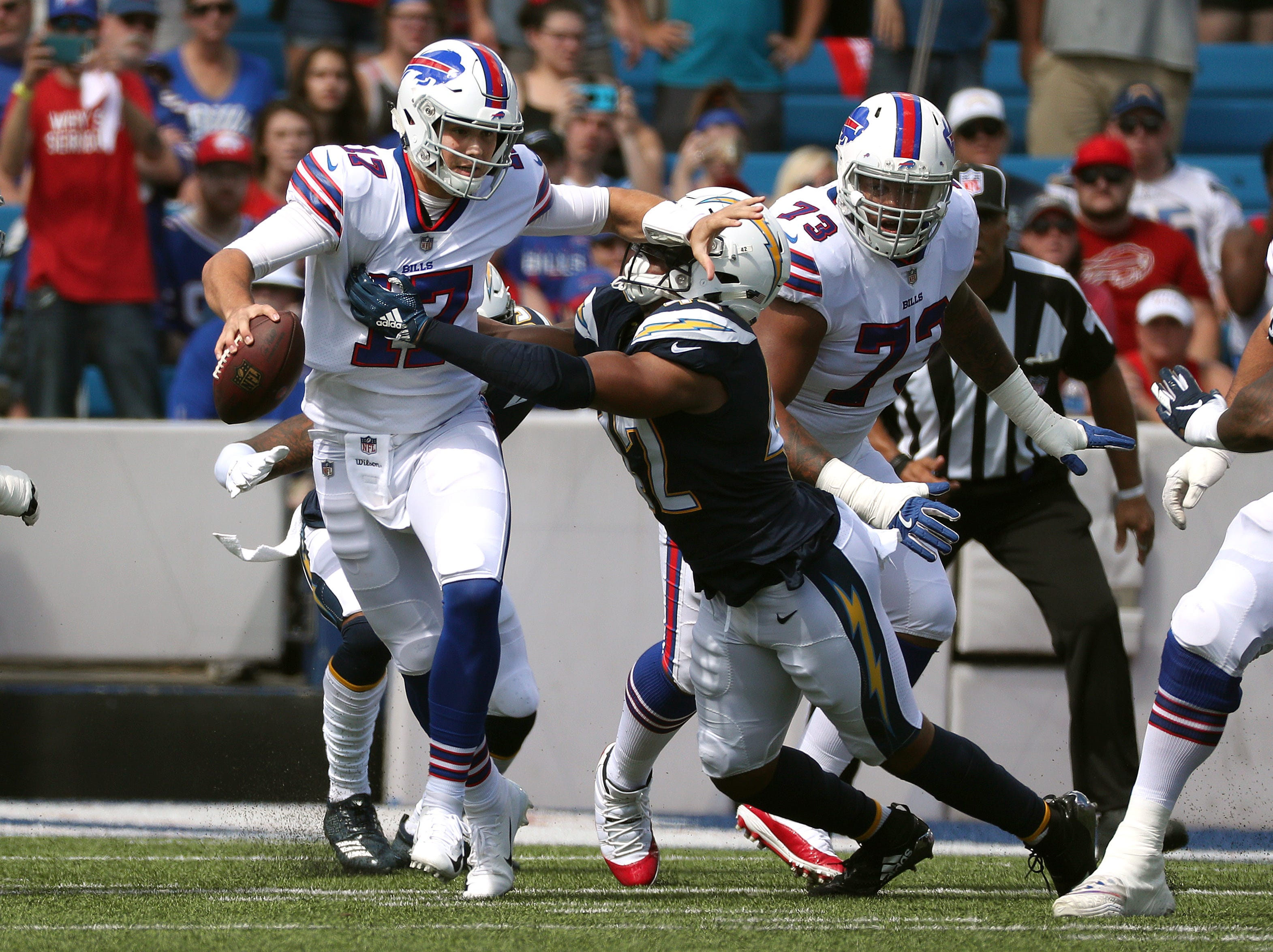 Bills quarterback Josh Allen is sacked by Chargers Uchenna Nwosu.