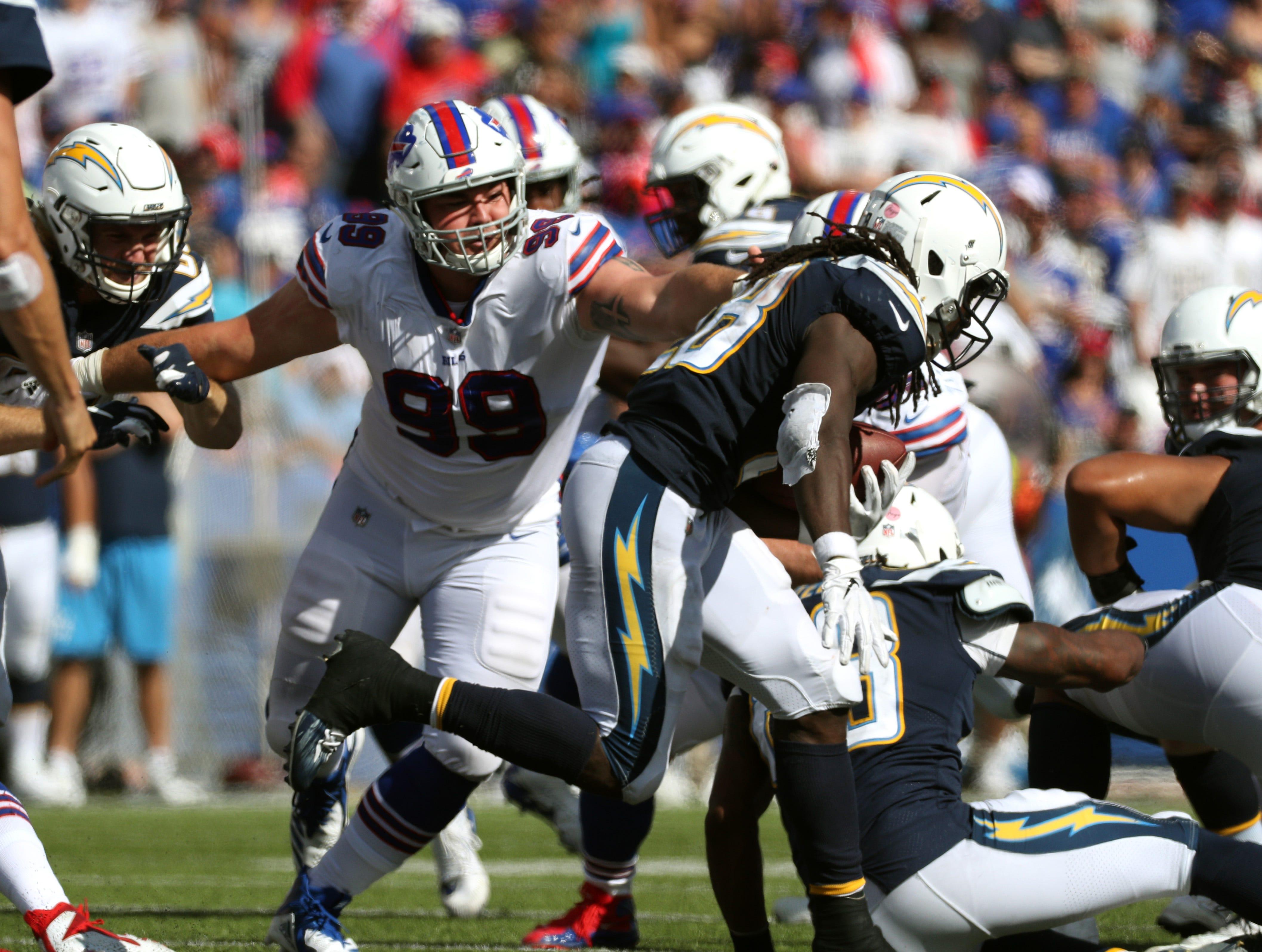 Bills rookie defensive lineman Harrison Phillips breaks through the line.